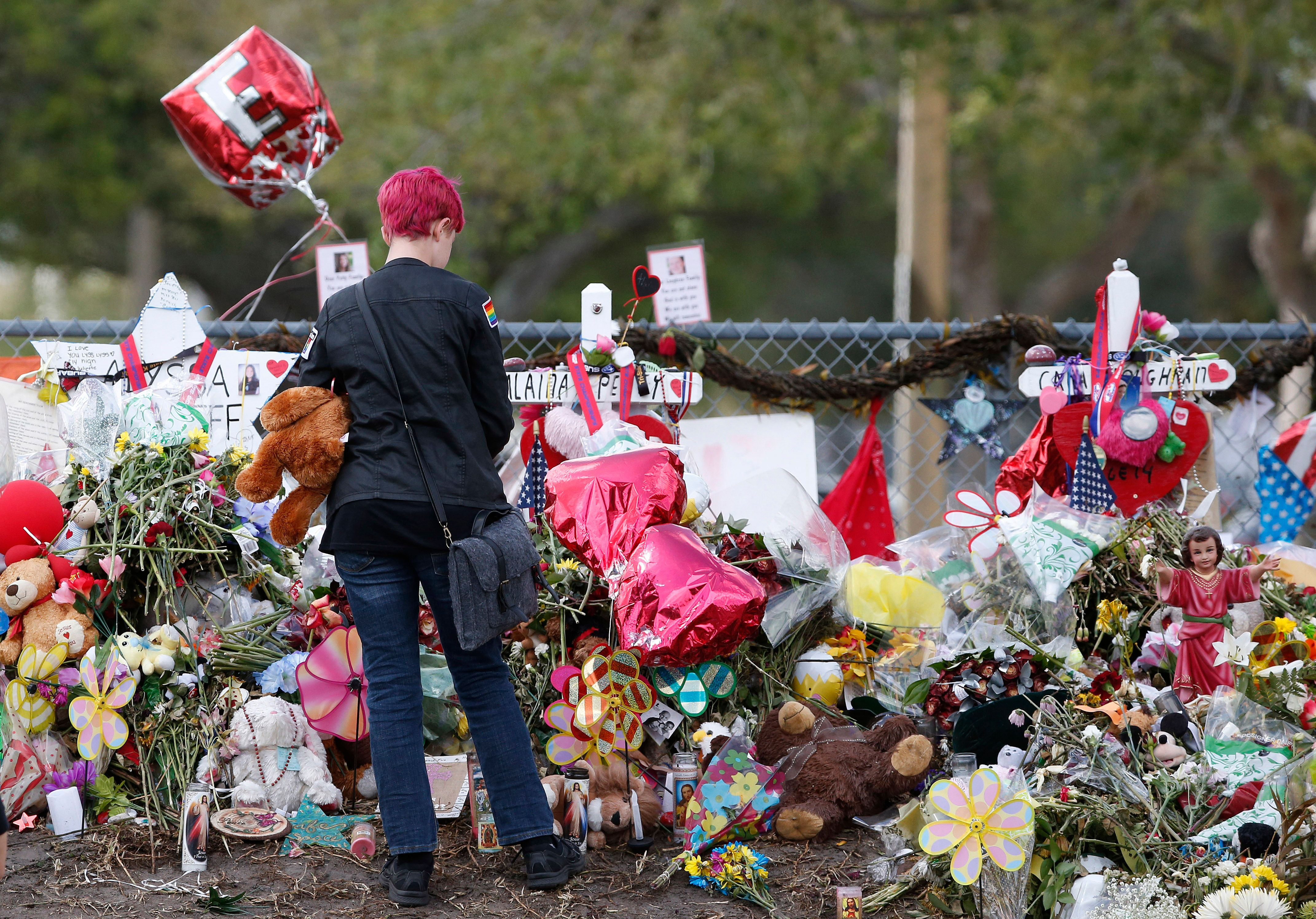 A Marjory Stoneman Douglas High School student at a memorial following students' return to school in Parkland, Florida on February 28, 2018.