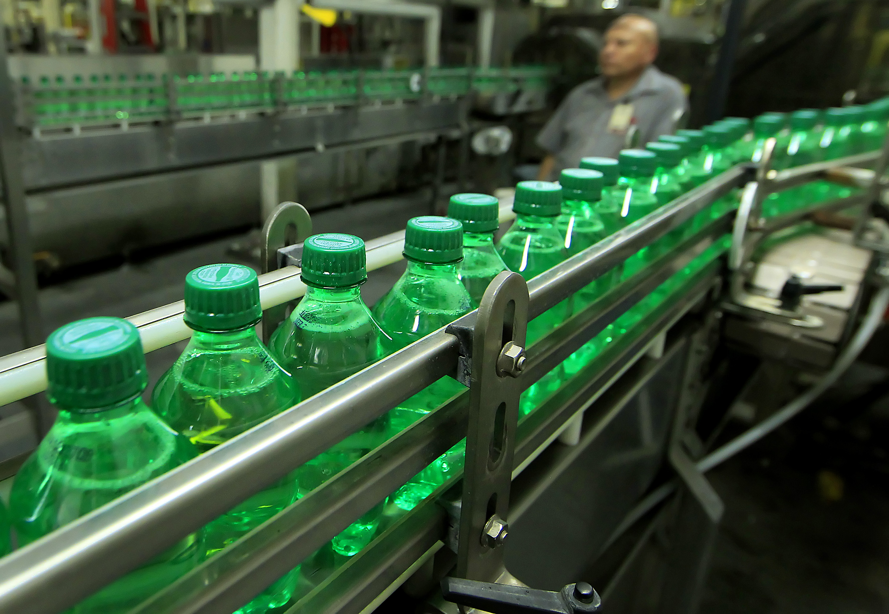 Bottles of Coca-Cola Co.'s Sprite on a conveyor belt at the company's bottling plant in Salt Lake City, Utah. Companies may start using more plastic bottles following Donald Trump's tariffs on steel and aluminum.