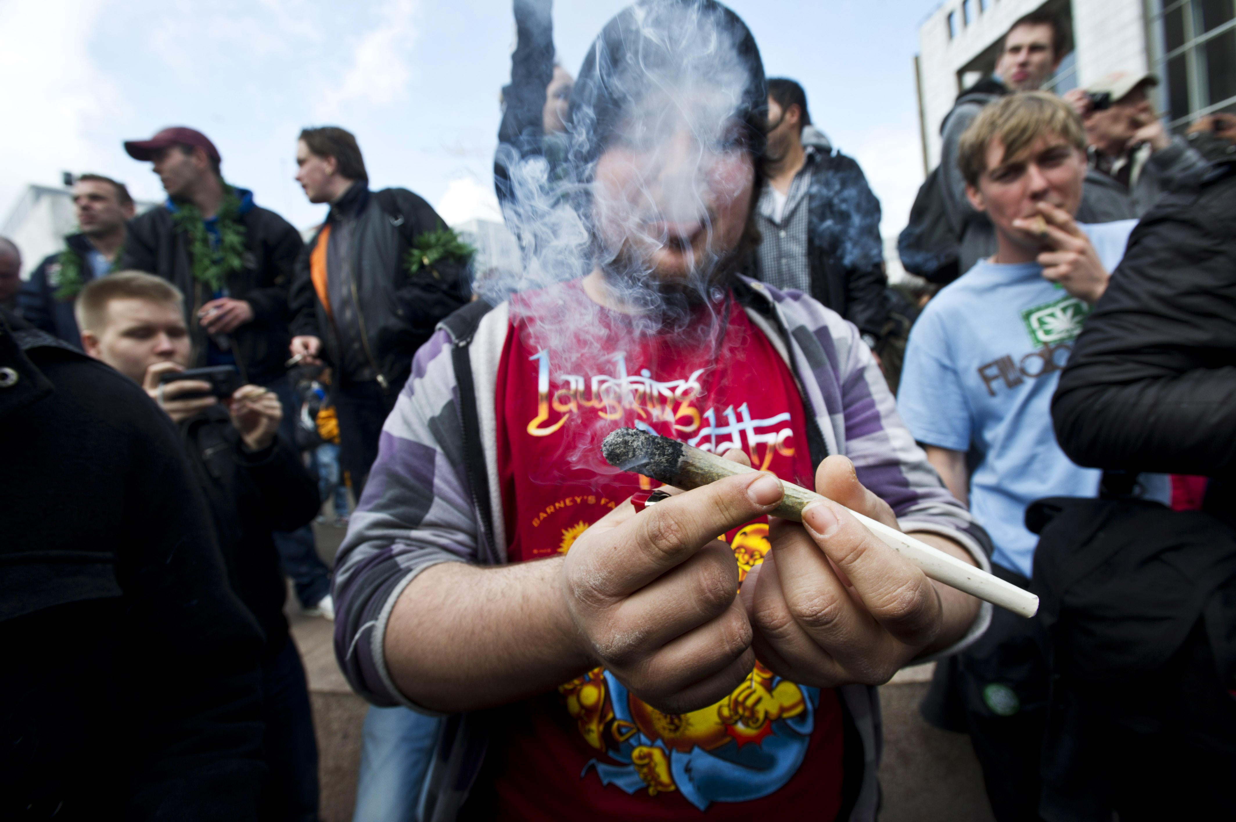 Amsterdam protesters smoke marijuana during a demo