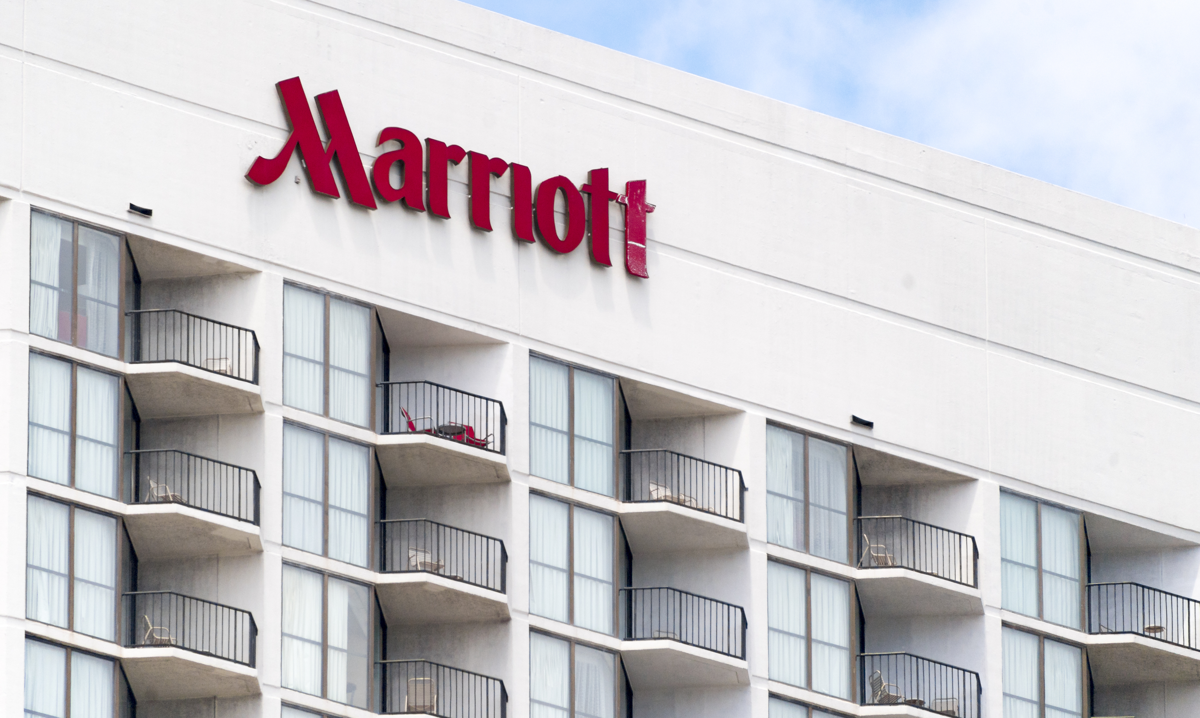 Marriott Hotel Sign or Logo. Upper floors with railings in
