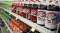 Two-liter bottles of Dr. Pepper appear on grocery store shelf