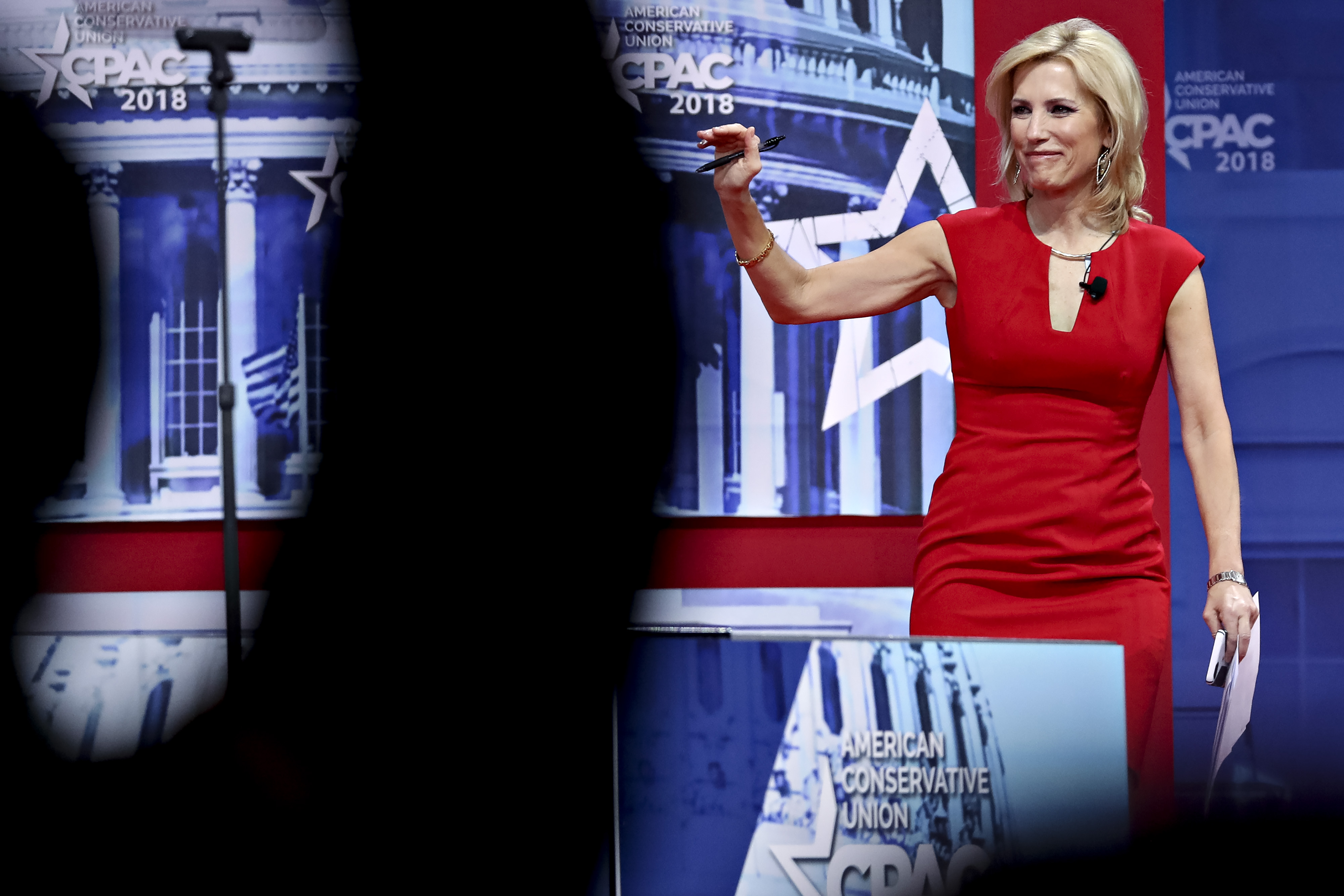Laura Ingraham appears on-stage at CPAC, waves to crowd