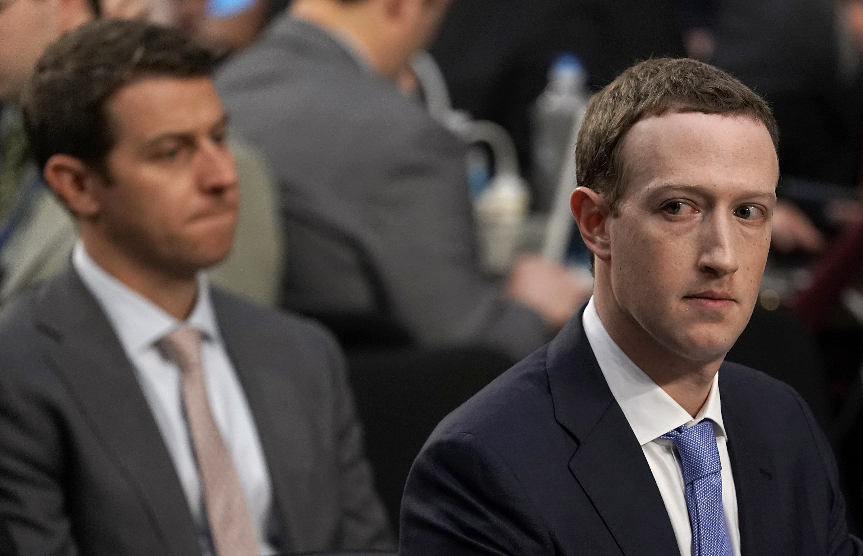 Facebook CEO Mark Zuckerberg glances sideways during Senate testimony.