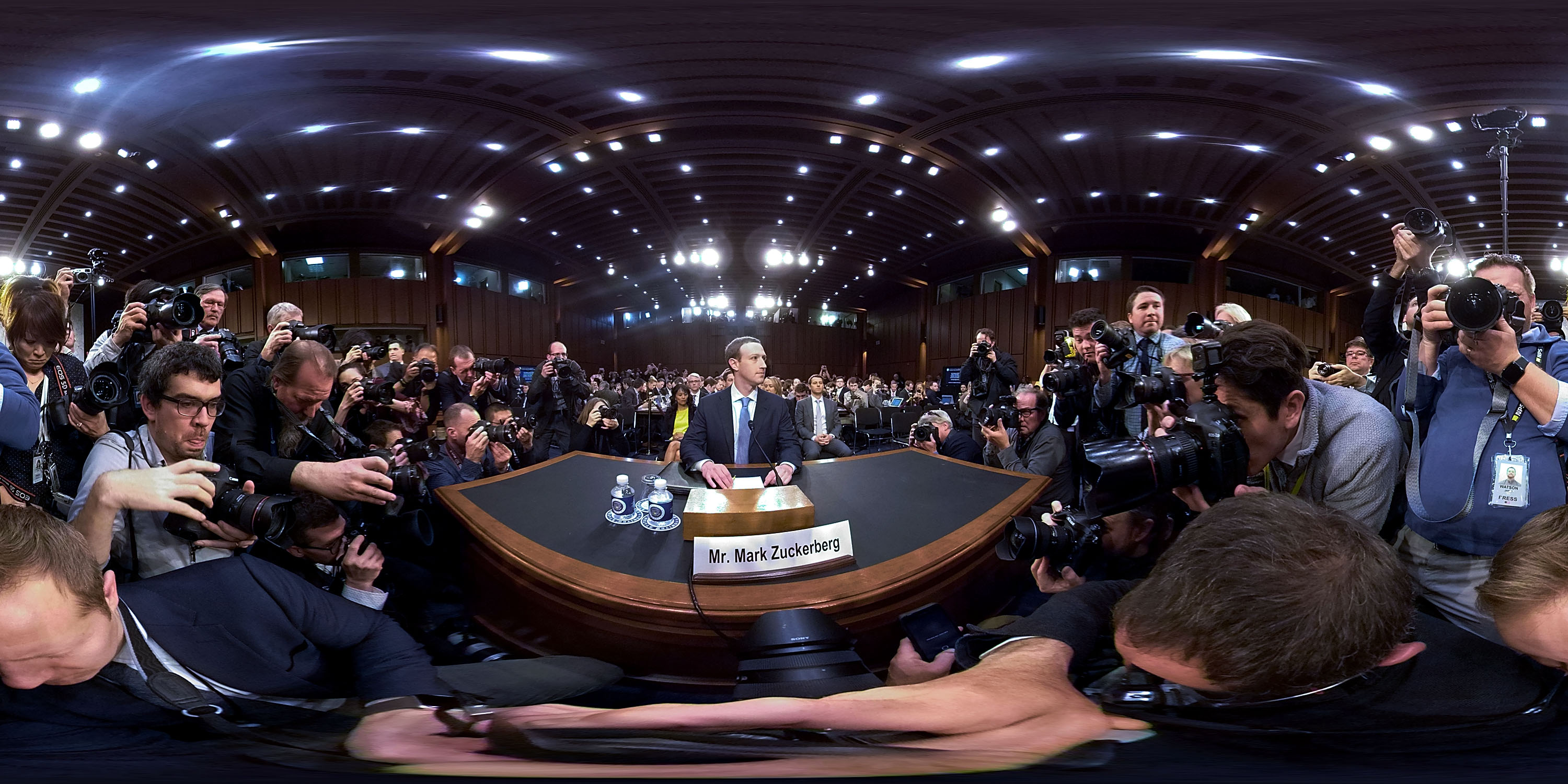 A wide-angle view of Facebook CEO Mark Zuckerberg at a desk before his Senate testimony.