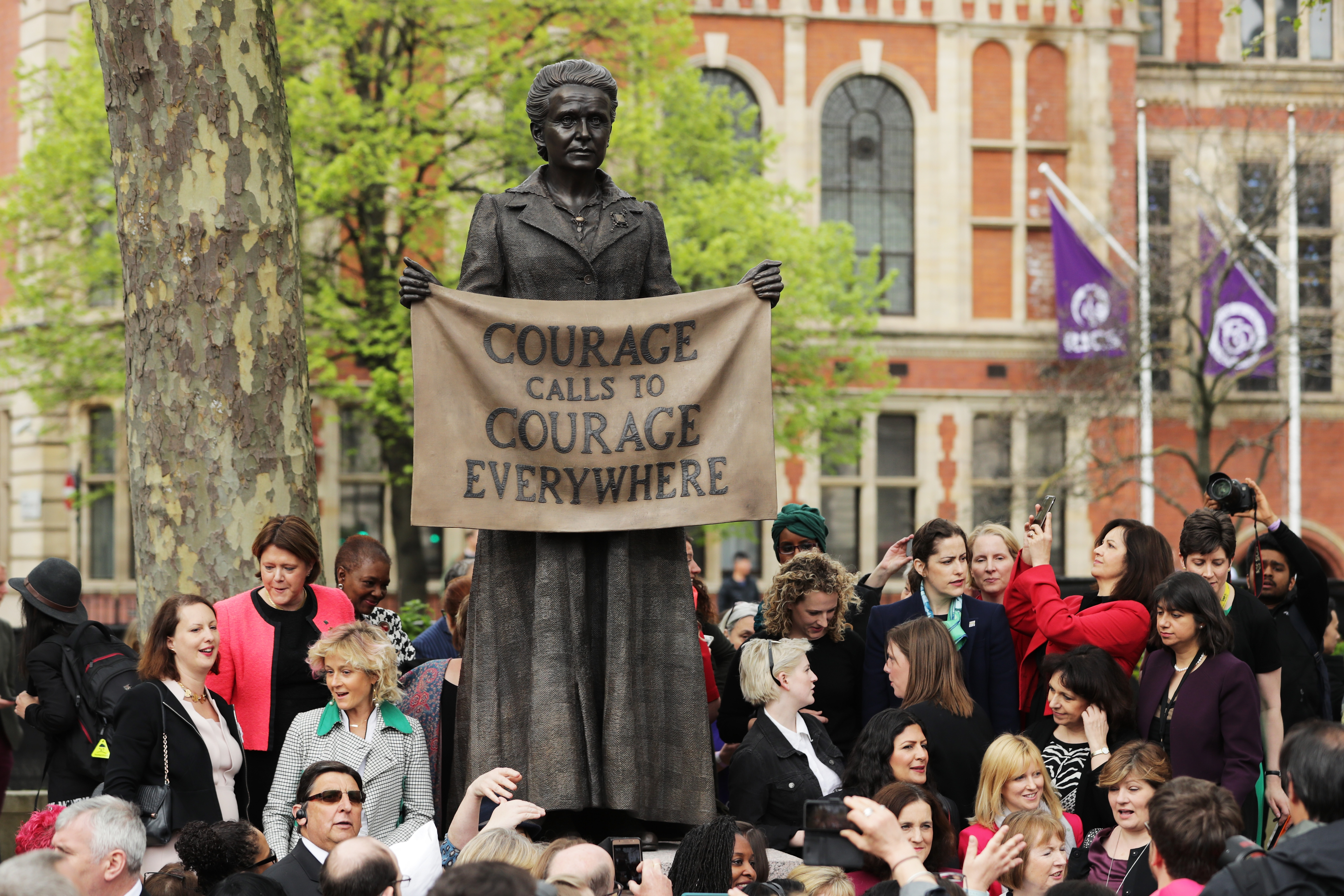 Crowd stands around news statue of Millicent Fawcett in Parliament Square in London