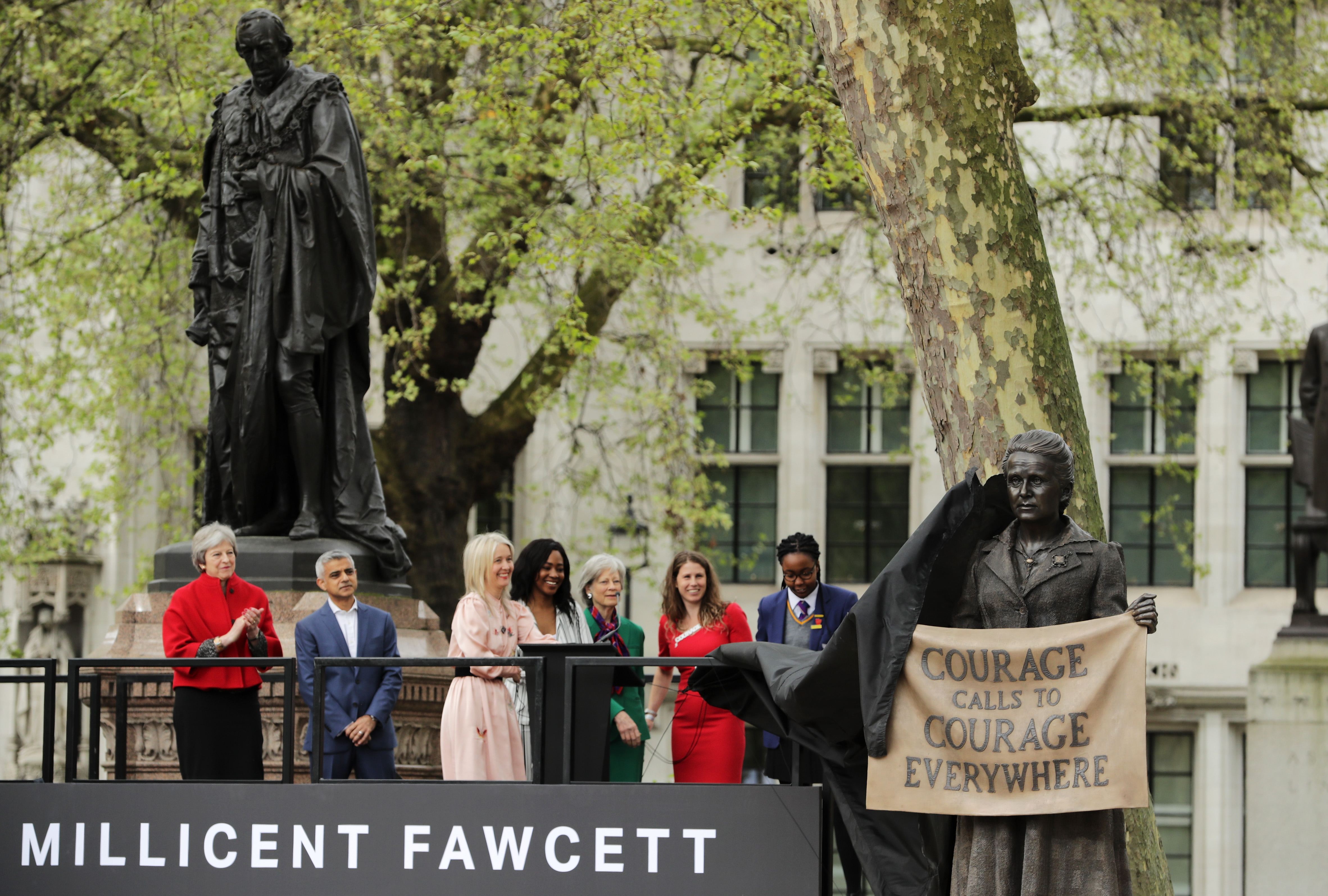 Black veil is pulled off statue to reveal Millicent Fawcett's likeness