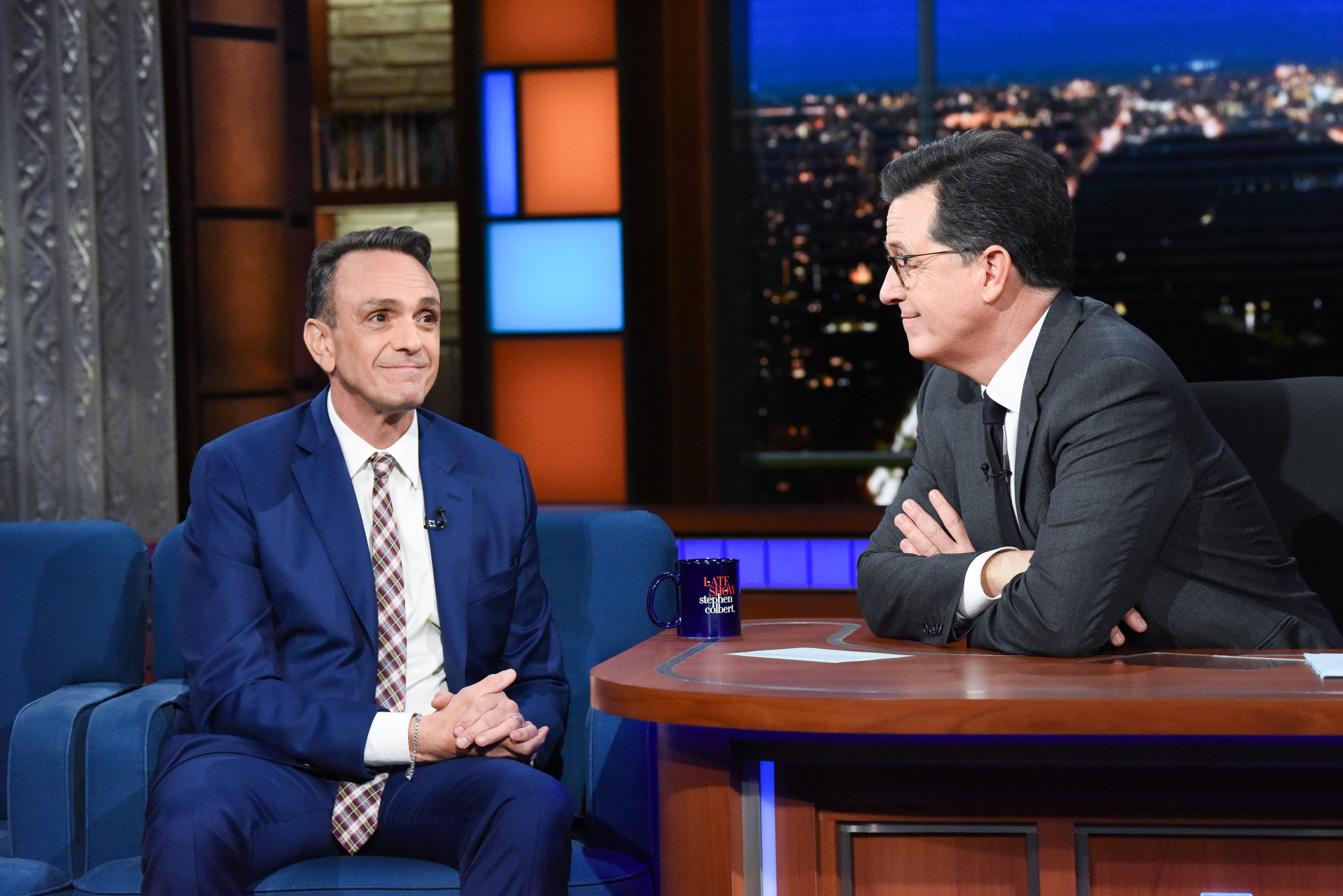 Hank Azaria sits for an interview with host Stephen Colbert