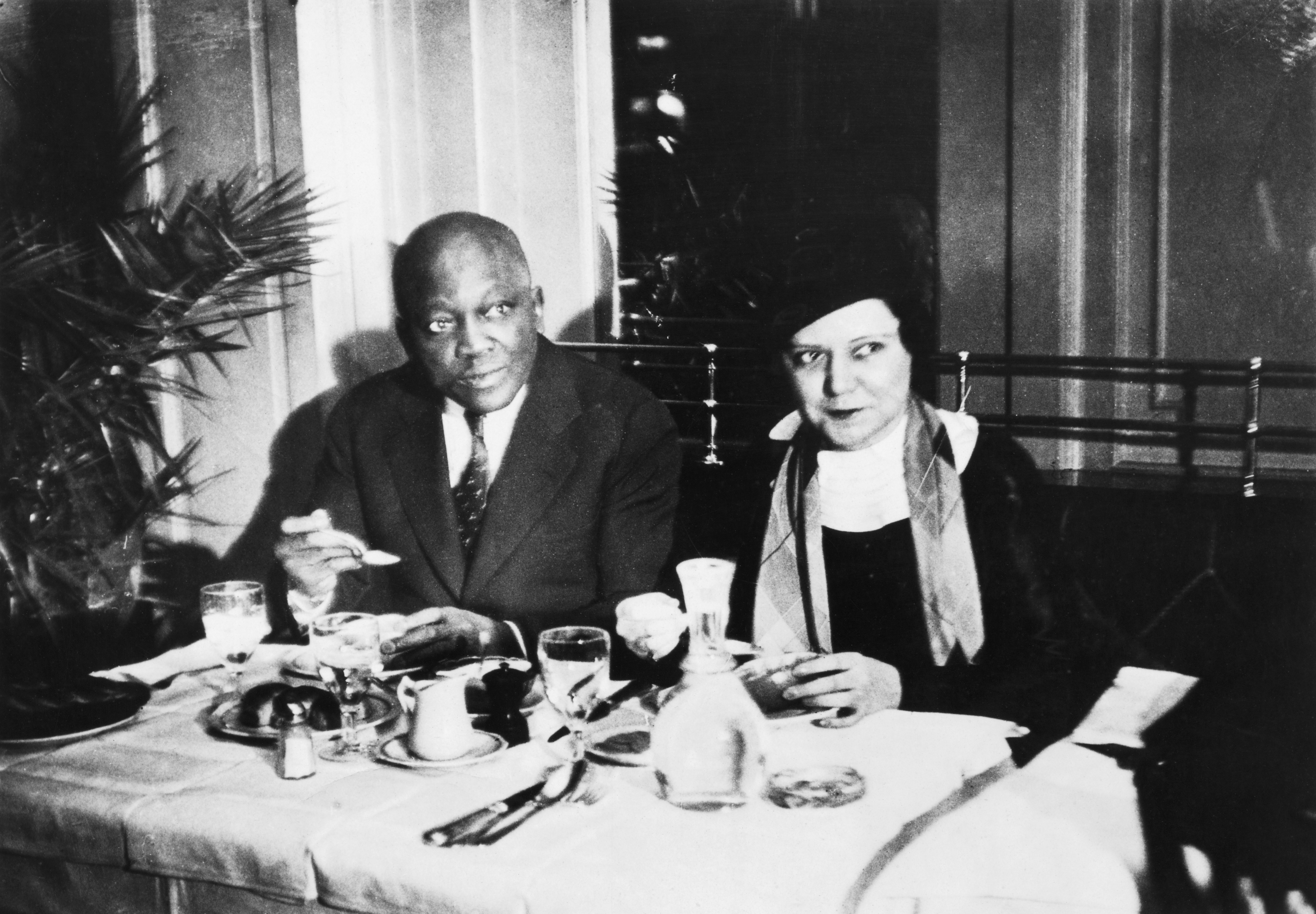 Jack Johnson and his wife Irene sit at a table which is set.