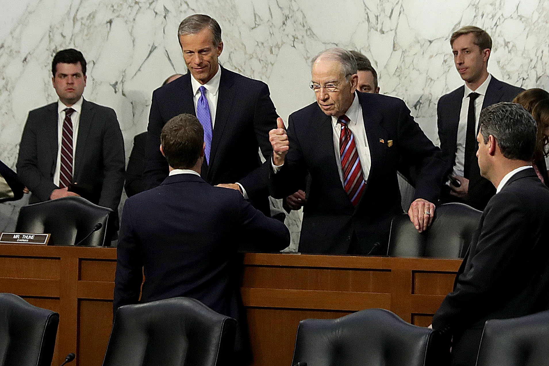 Facebook CEO Mark Zuckerberg shakes hands with senators after his congressional testimony on April 10, 2018.