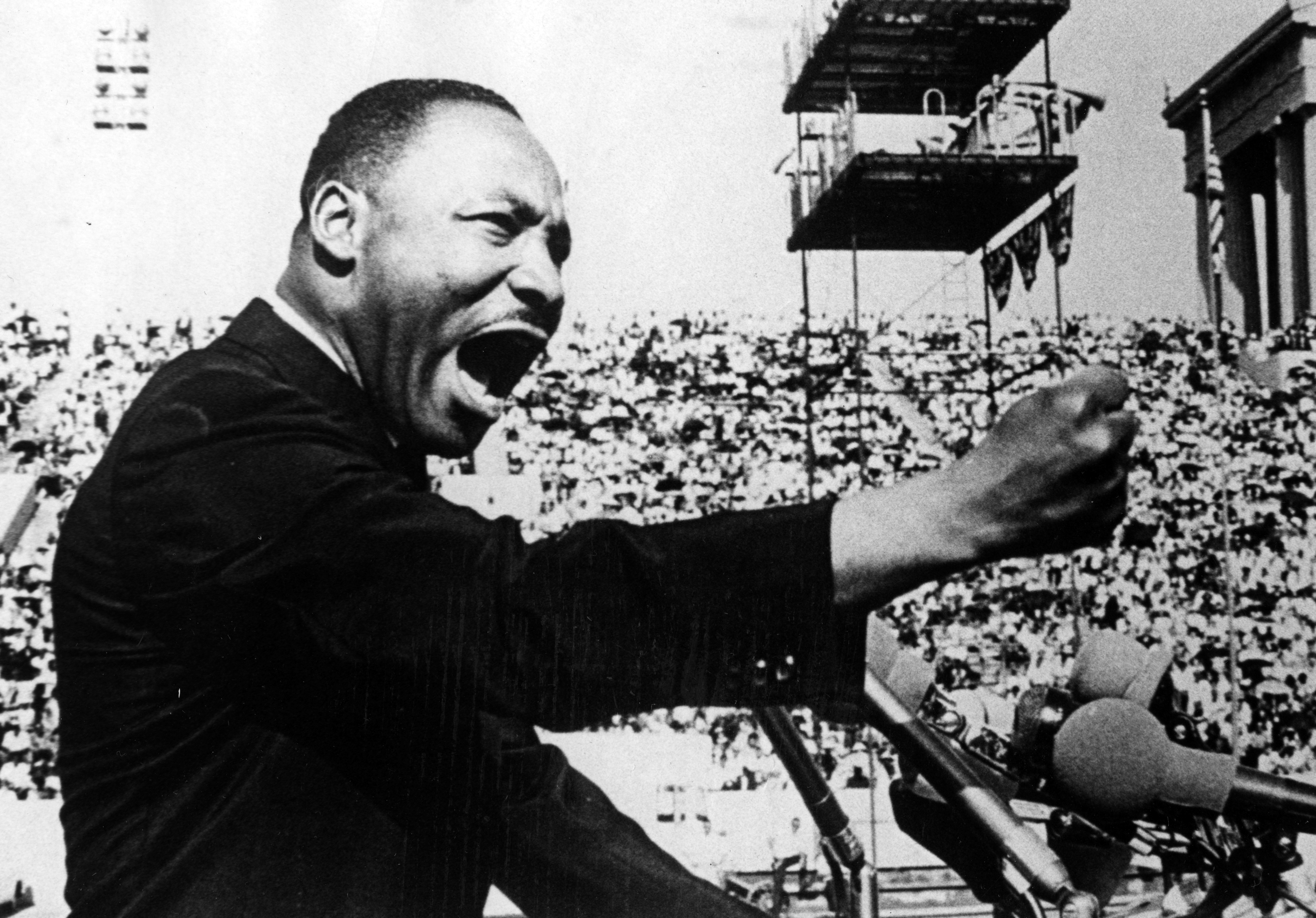 Dr. Martin Luther King Jr. gestures emphatically during a speech at a Chicago Freedom Movement rally in Soldier Field, Chicago, Illinois, July 10, 1966.