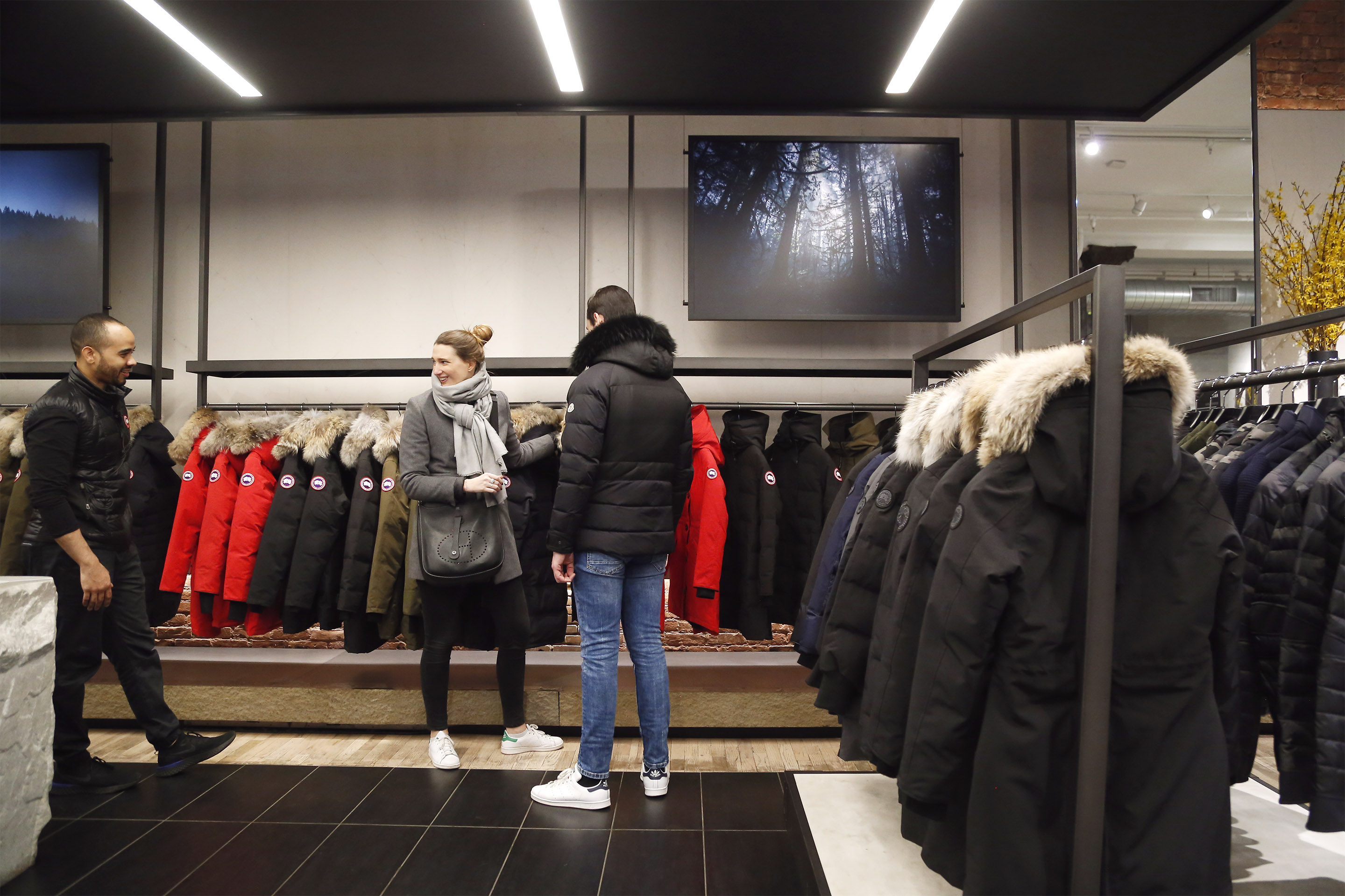 Shoppers browsing Canada Goose's parkas in Manhattan flagship store.