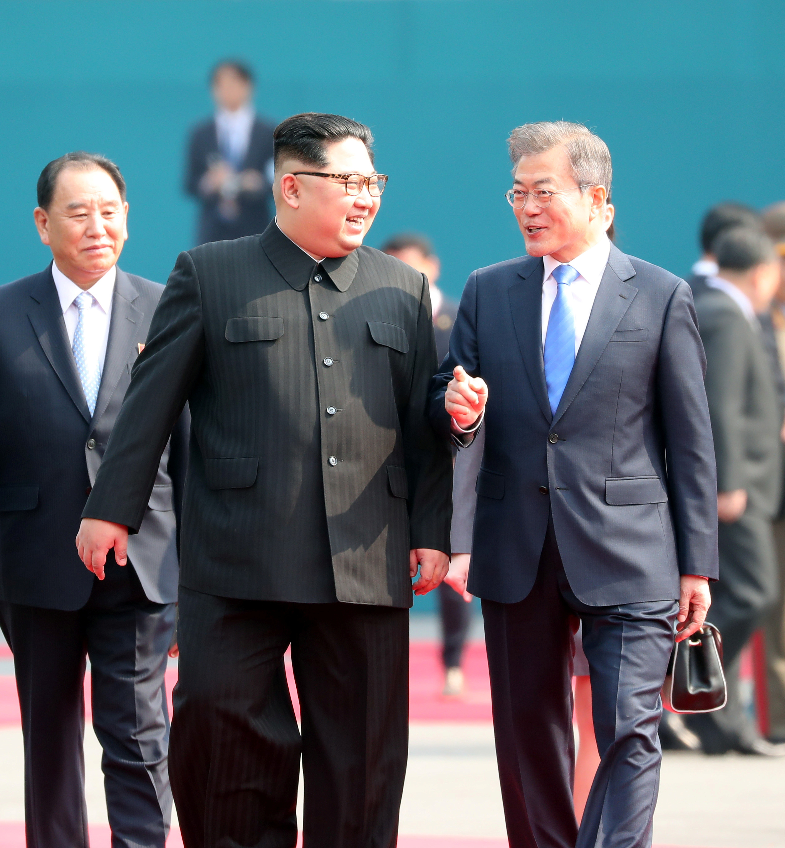 South Korean President Moon Jae-in and North Korean leader Kim Jong Un arrive at the Peace House
