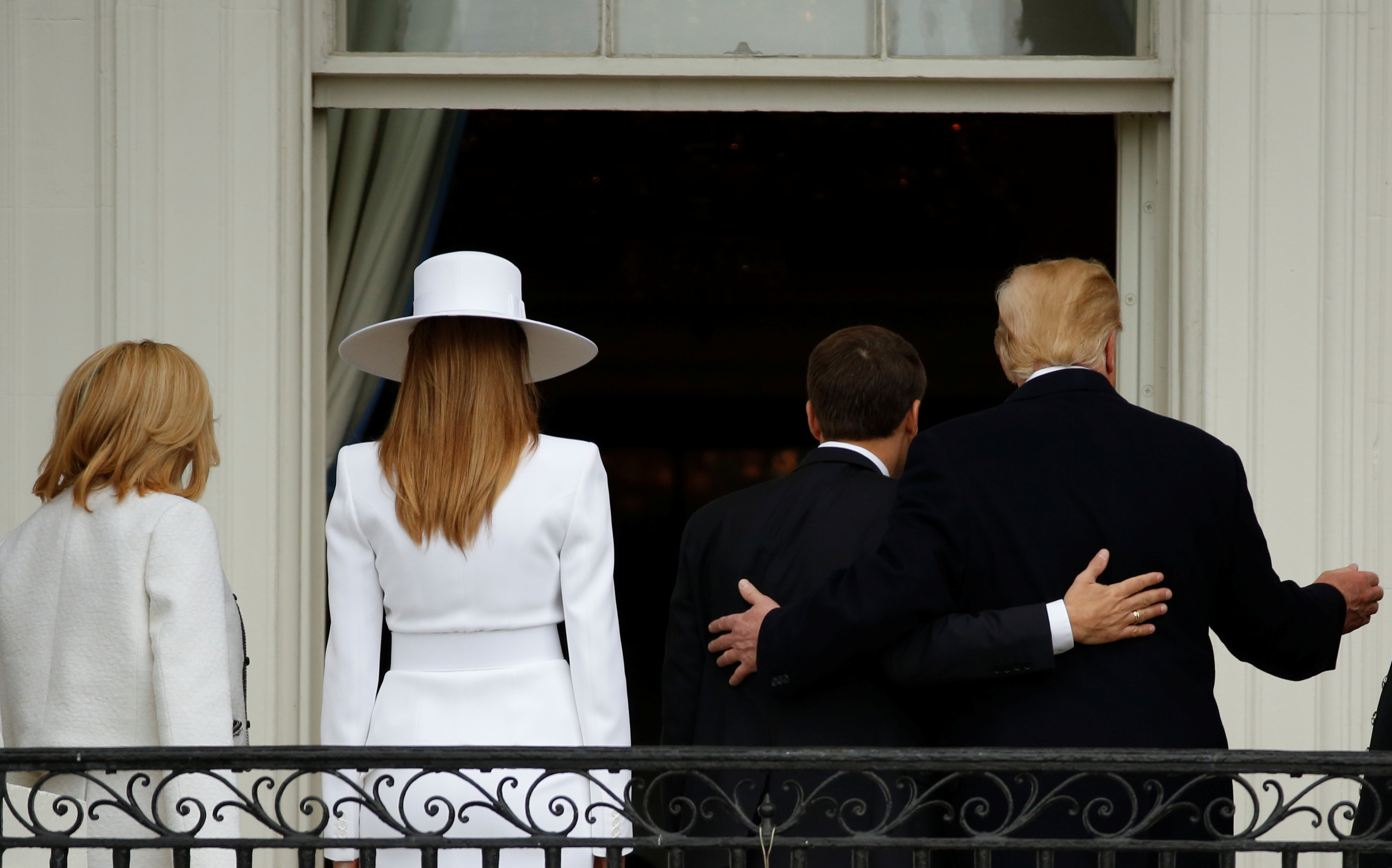 U.S. President Donald Trump and first lady Melania Trump welcome French President Emmanuel Macron and his wife Brigitte Macron during an arrival ceremony at the White House in Washington