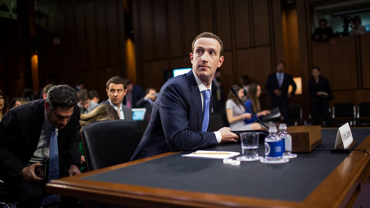 Facebook CEO Mark Zuckerberg addresses a senate hearing.