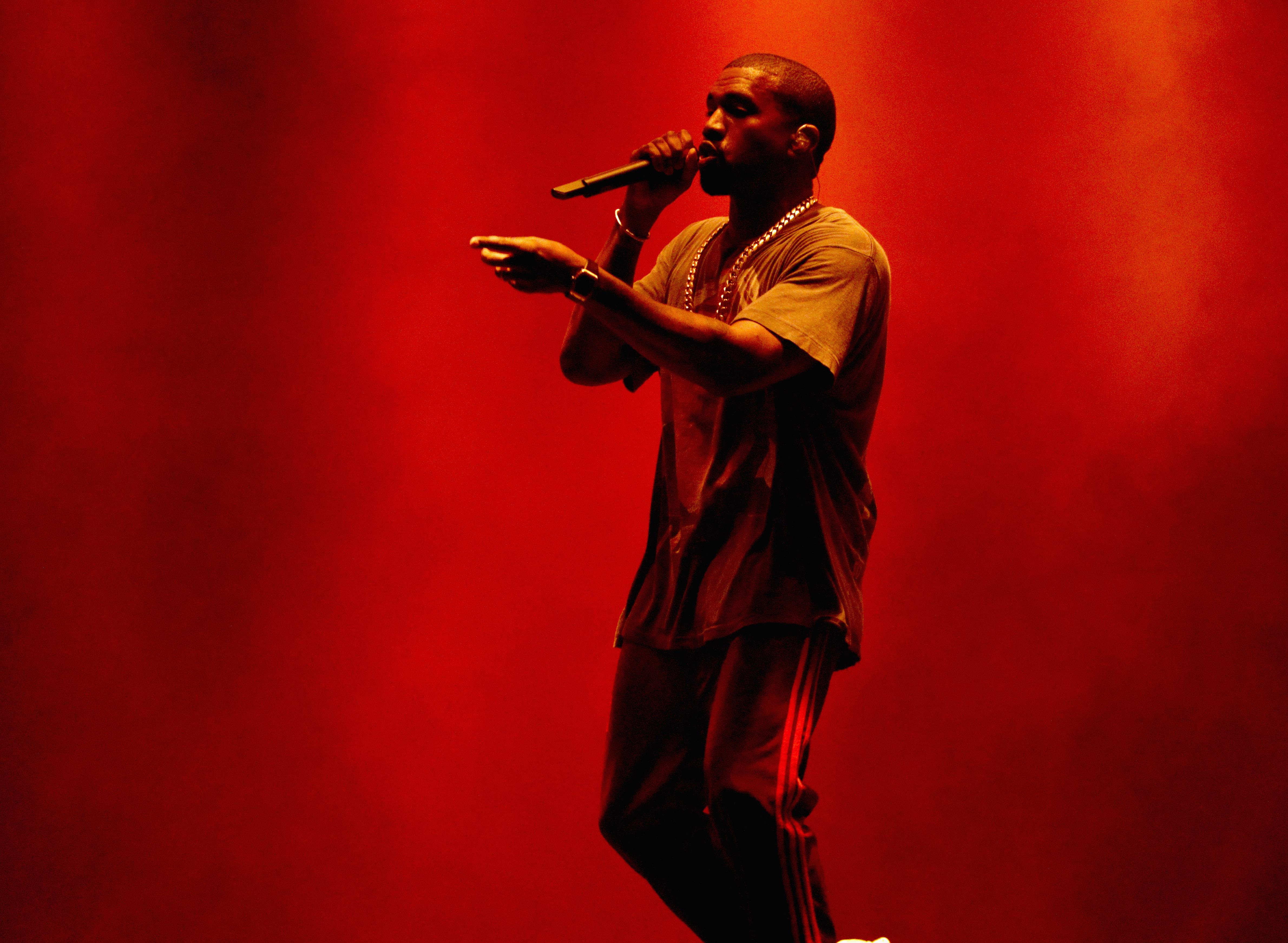 Kanye West onstage performing