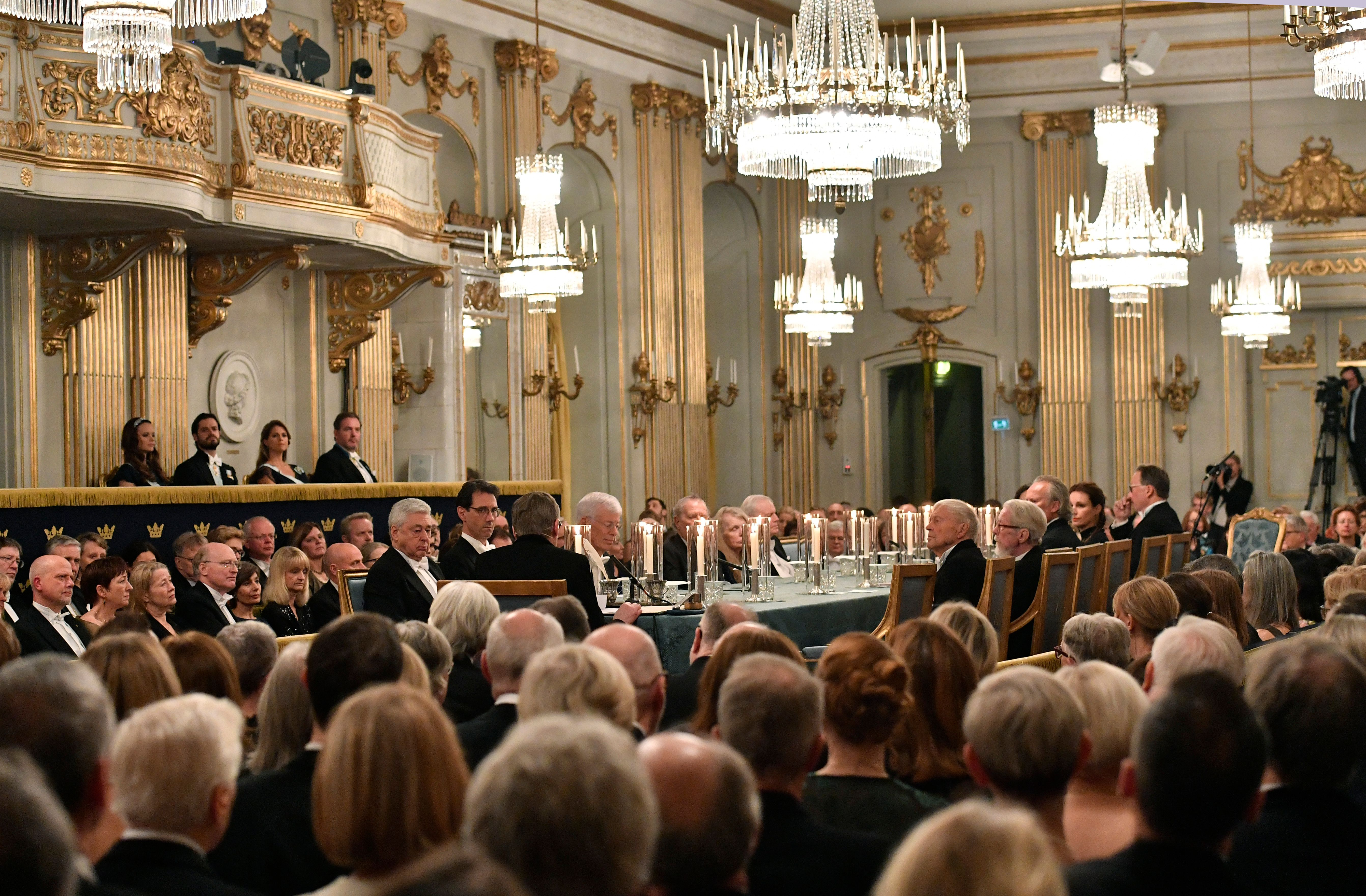Guests attend Swedish Academy's annual meeting in December where they sit at long, lavish table.