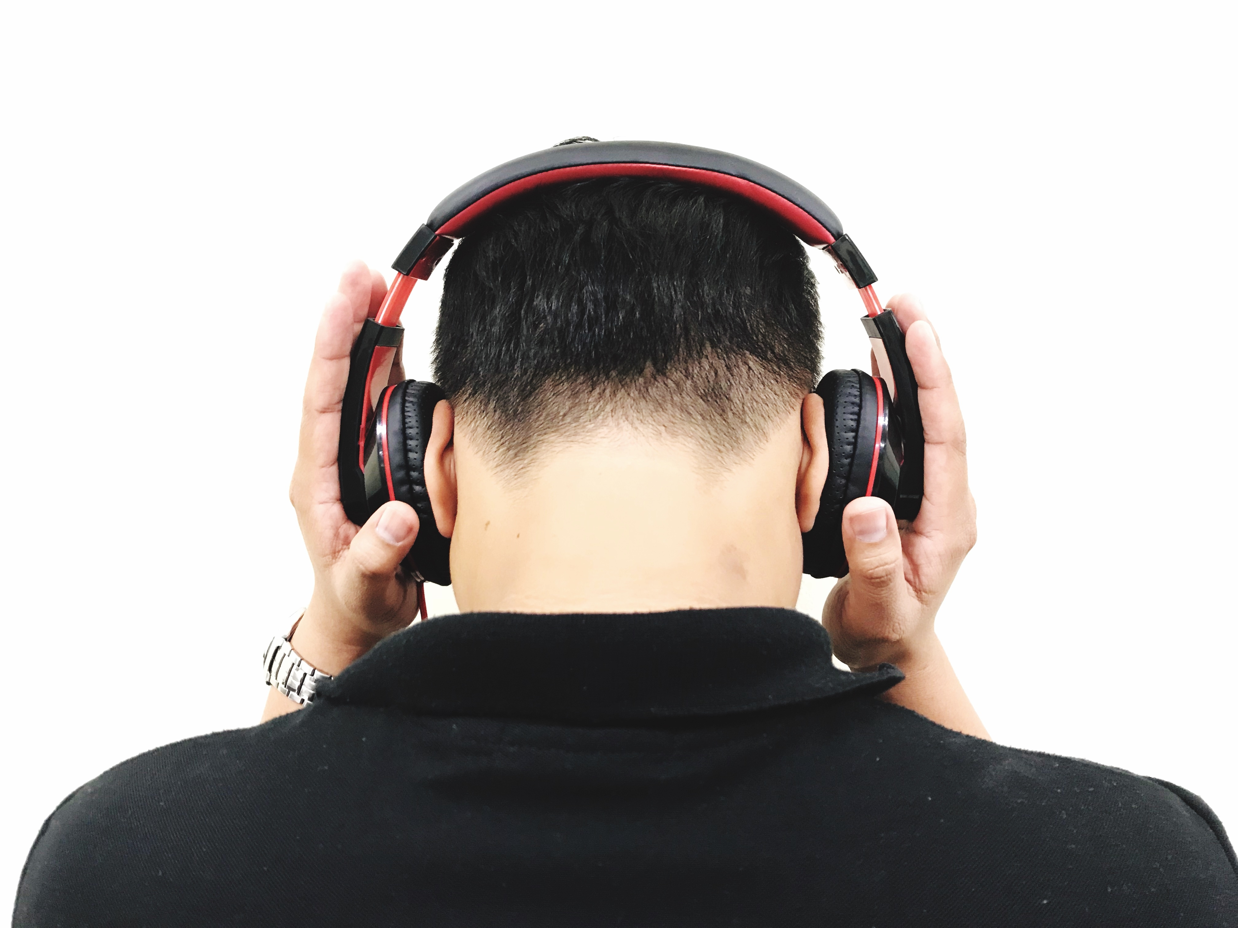 Rear View Of Man Listening Music Over White Background