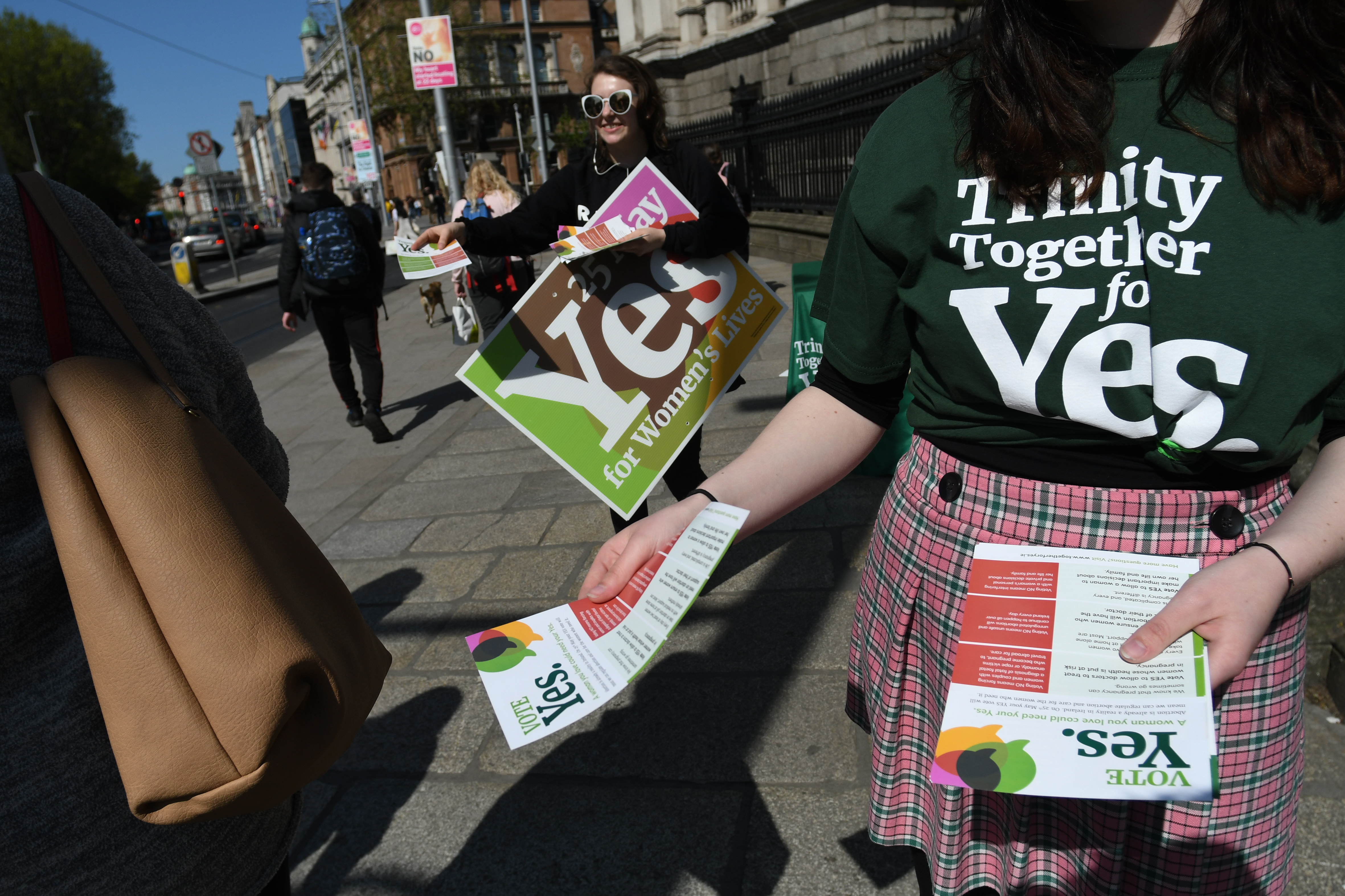 Activists from the 'Trinity Together for Yes' campaign canvass in front of Trinity College, urging a 'yes' vote.