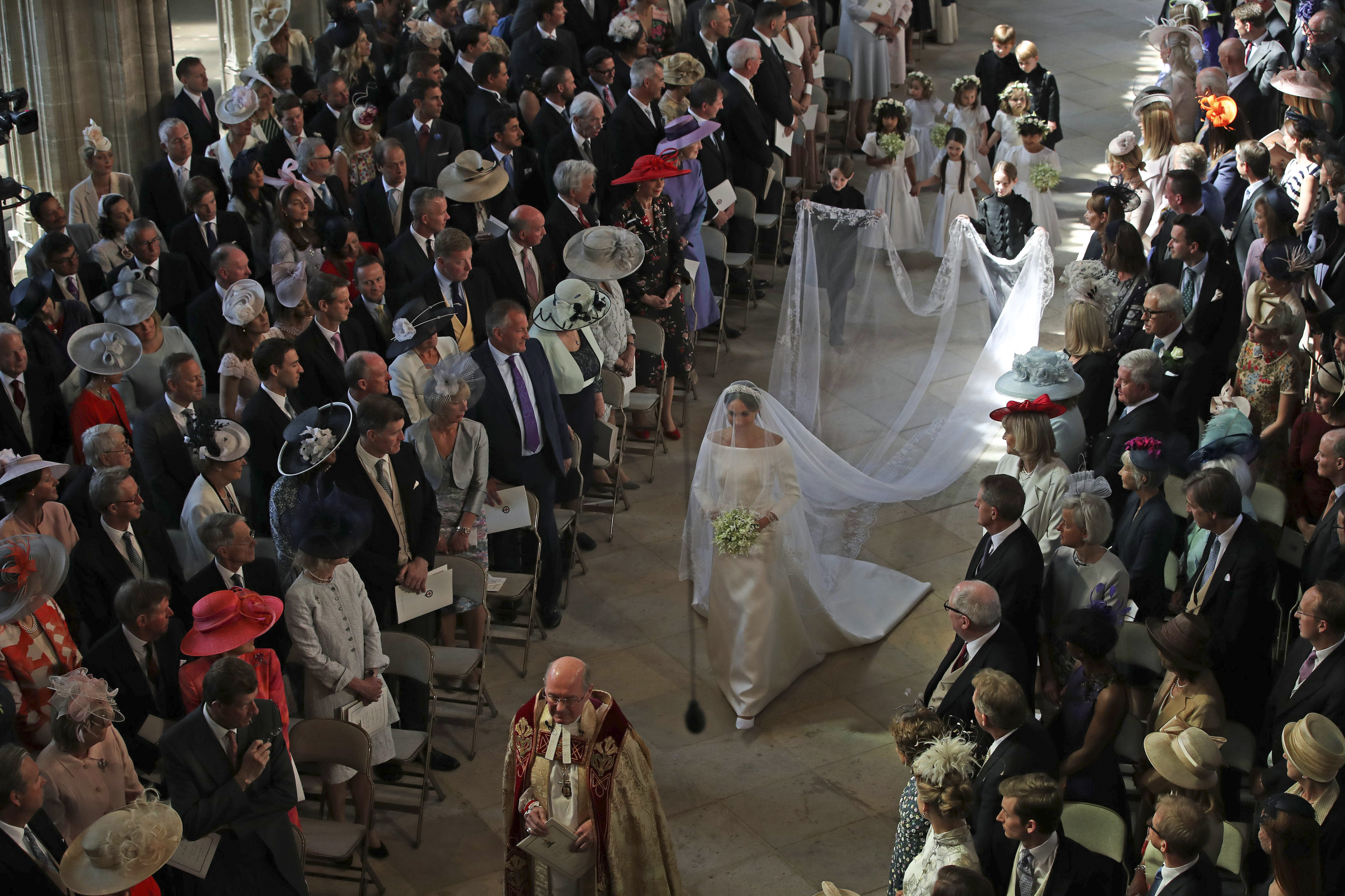 Meghan Markle, in Givenchy wedding dress, walks the majority of the aisle by herself.