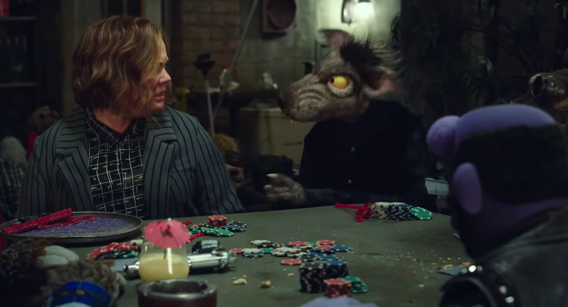 "Melissa McCarthy and co-stars in ""The Happytime Murders."""