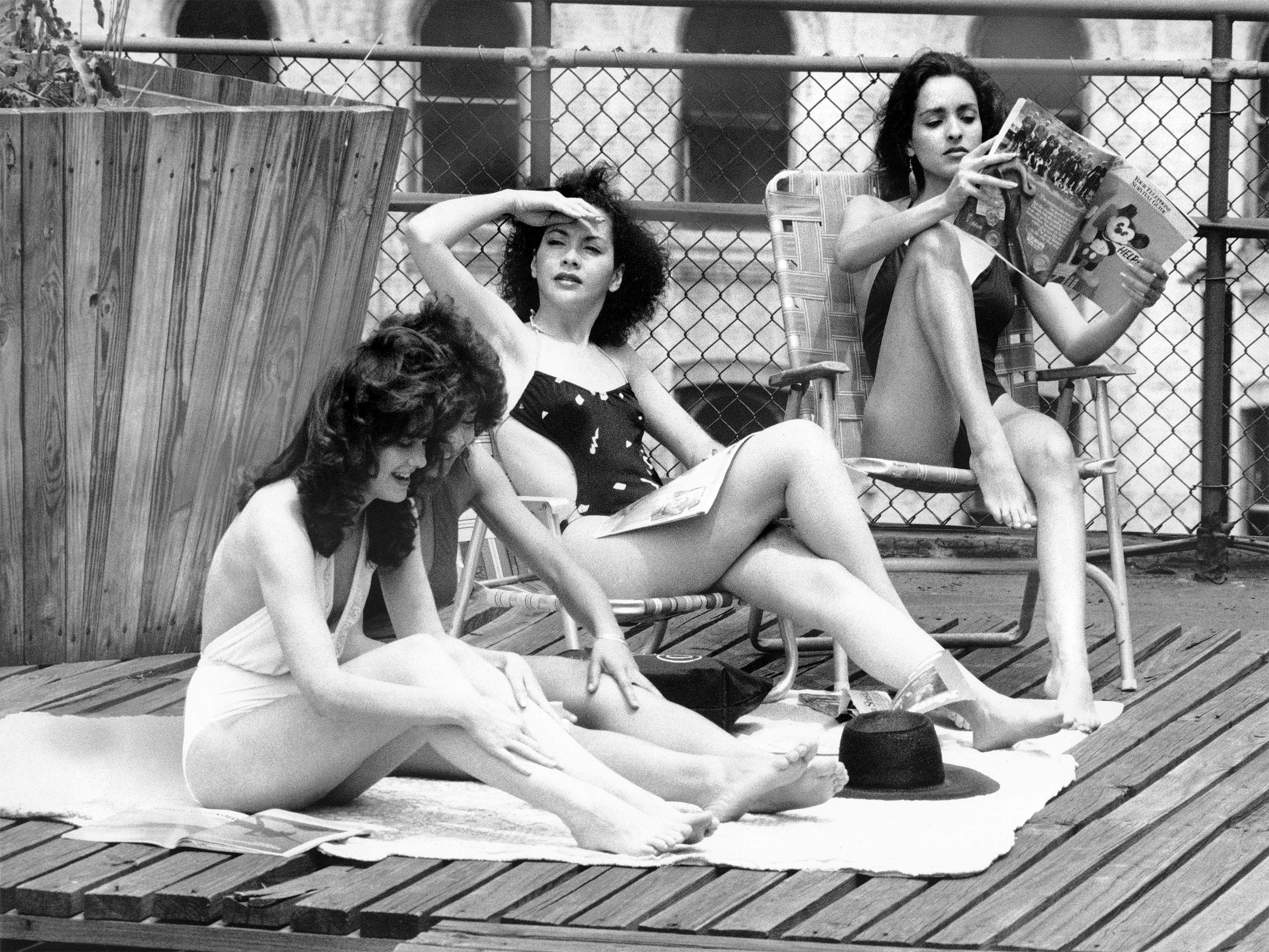 Upon the roof of a building on East 39th Street, models (lef