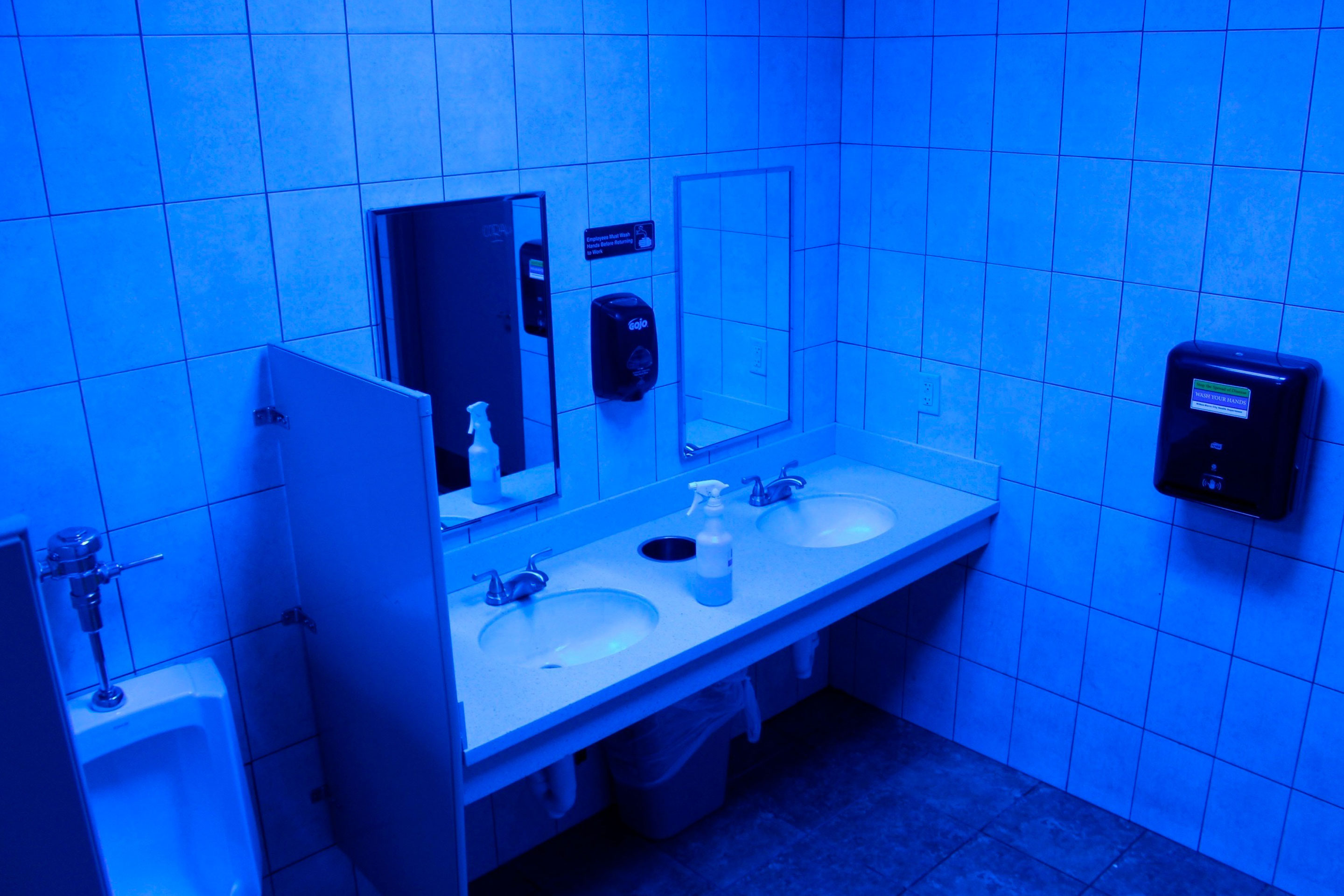 A public bathroom bathed in blue light is seen at this Turkey Hill convenience store in Wilkes-Barre, Pa.
