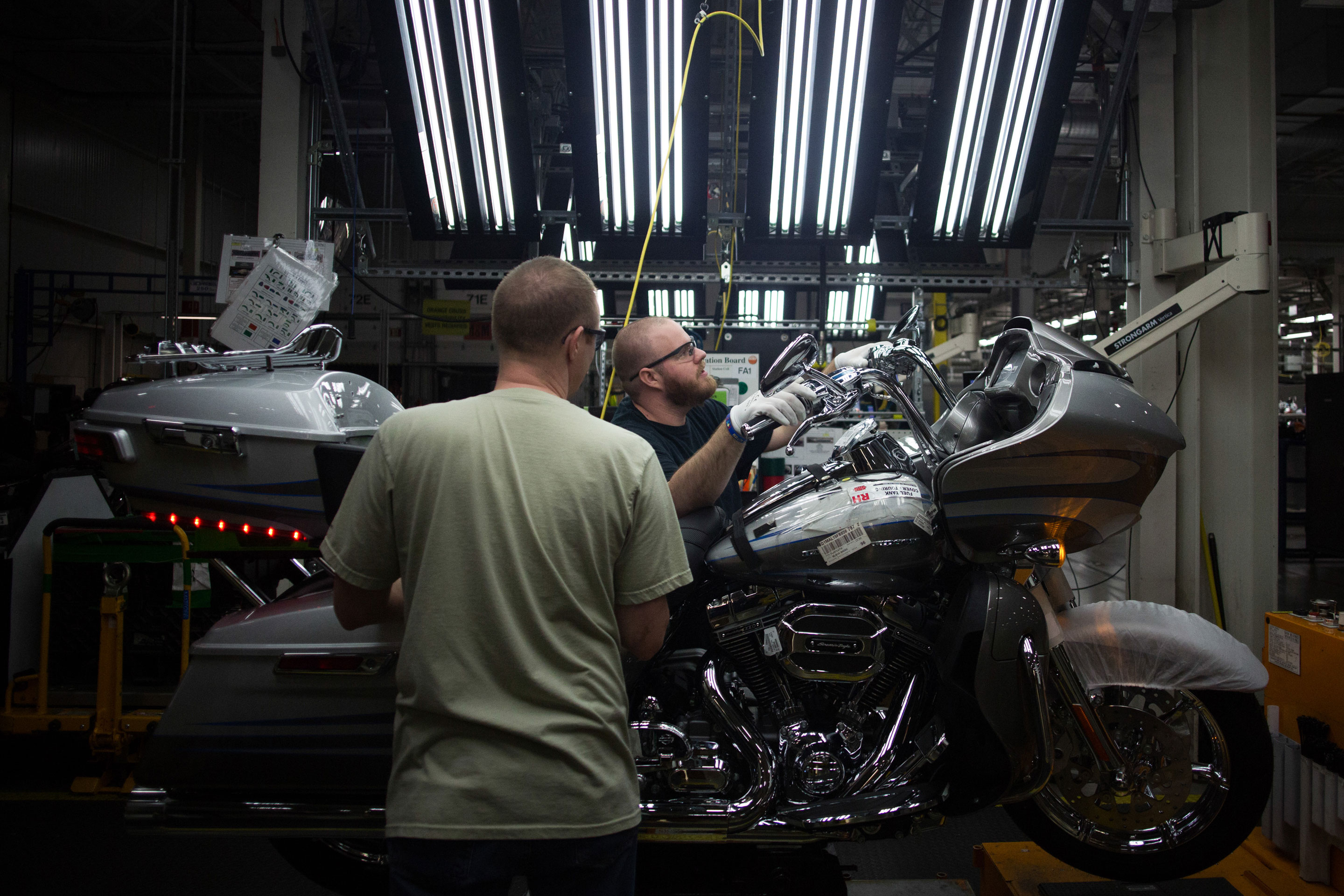 Employees work on the assembly line at the Harley-Davidson Inc. manufacturing facility in York, Pennsylvania, U.S., in 2015.