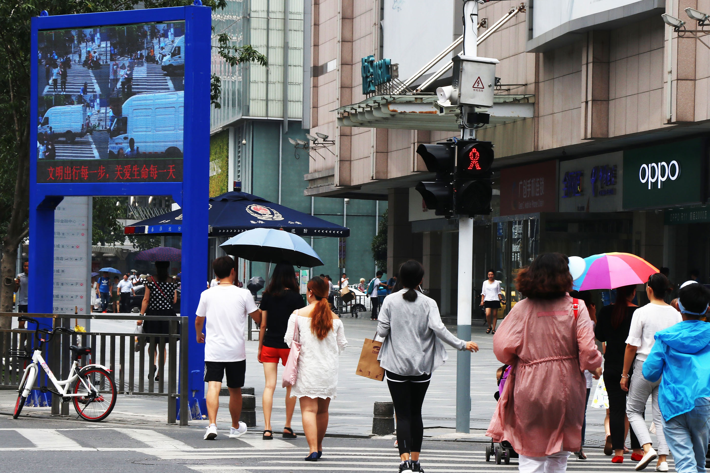 Facial-recognition technology, driven by artificial intelligence, is in increasingly wide use in China. Here, a screen  supported by a facial-recognition system displays the image of a jaywalker at an intersection in Nanjing.