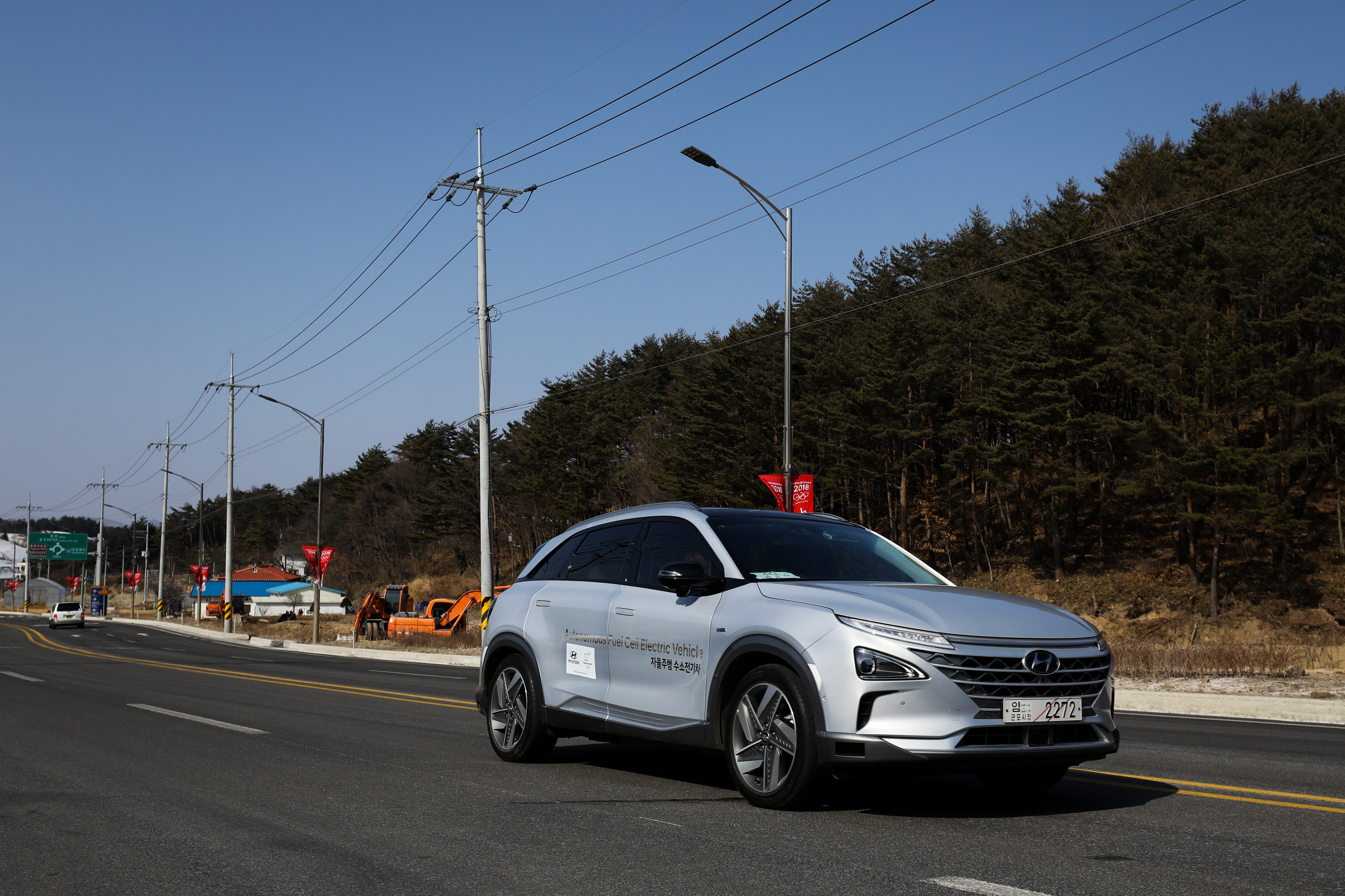 A Hyundai Nexo autonomous fuel cell electric vehicle travels along a road during a test drive in Pyeongchang, South Korea.