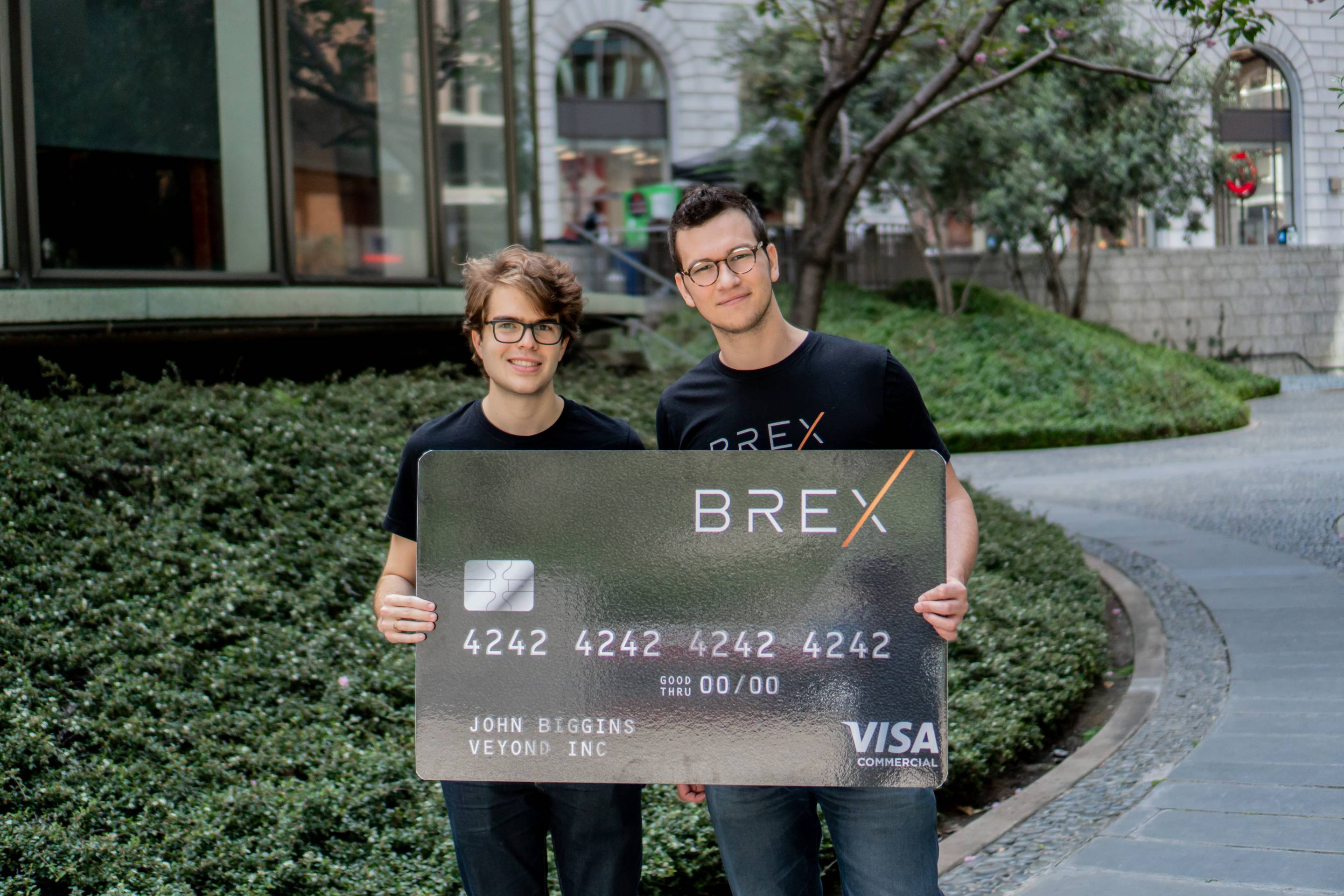 Brex cofounders Pedro Franceschi (left) and Henrique Dubugras, CEO, hold up an oversized version of the credit card they are providing to other startups.