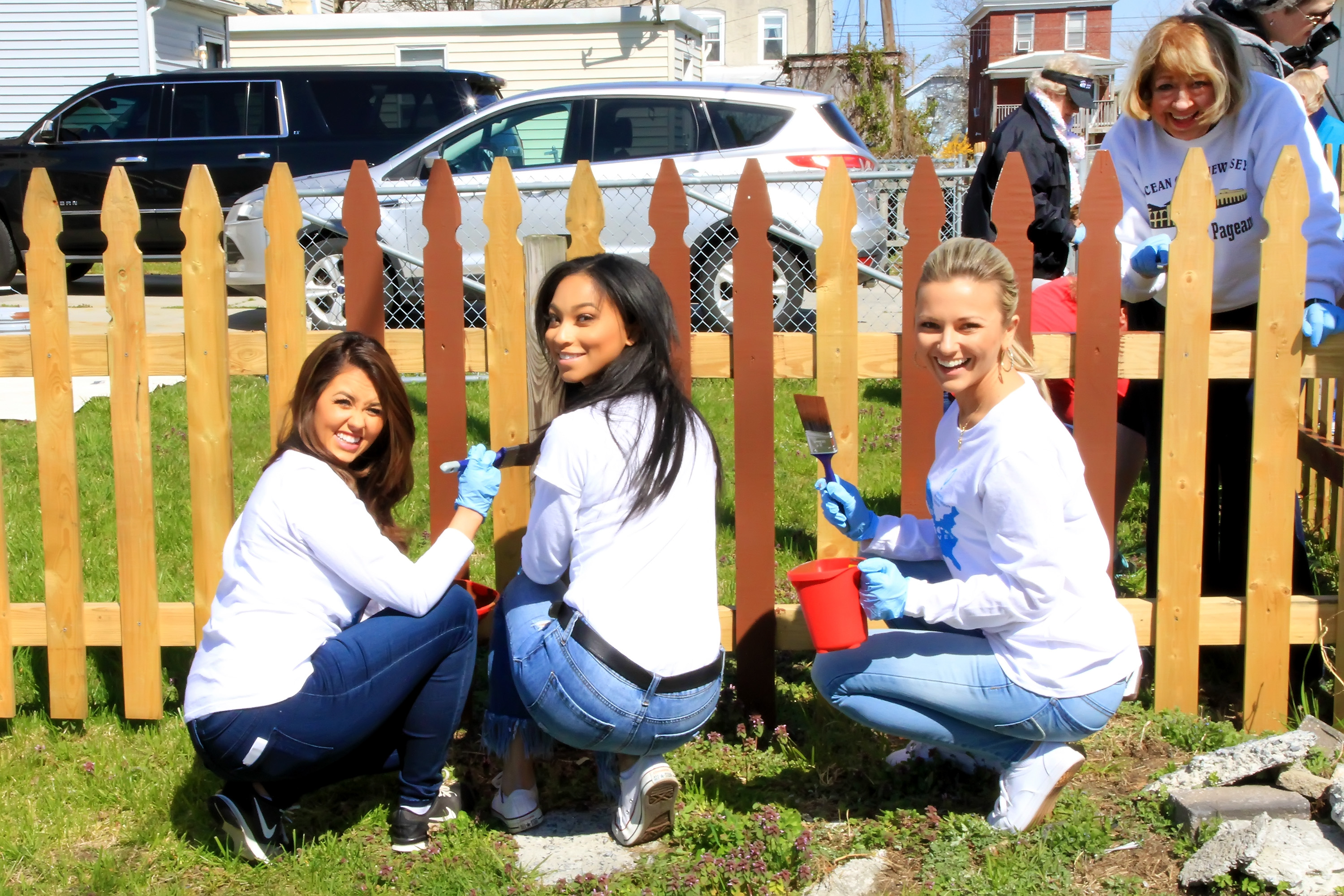 Miss America 2018 Cara Mund and other contestants paint a fence for Habit for Humanity project in Atlantic City, New Jersey.