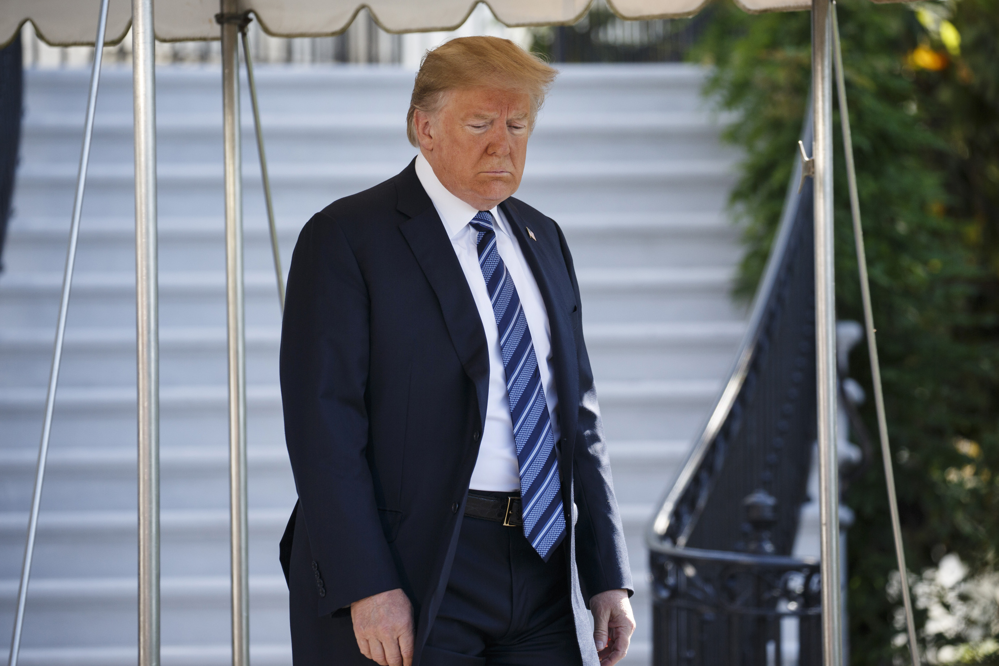 U.S. President Donald Trump exits the White House to board Marine One in Washington D.C.