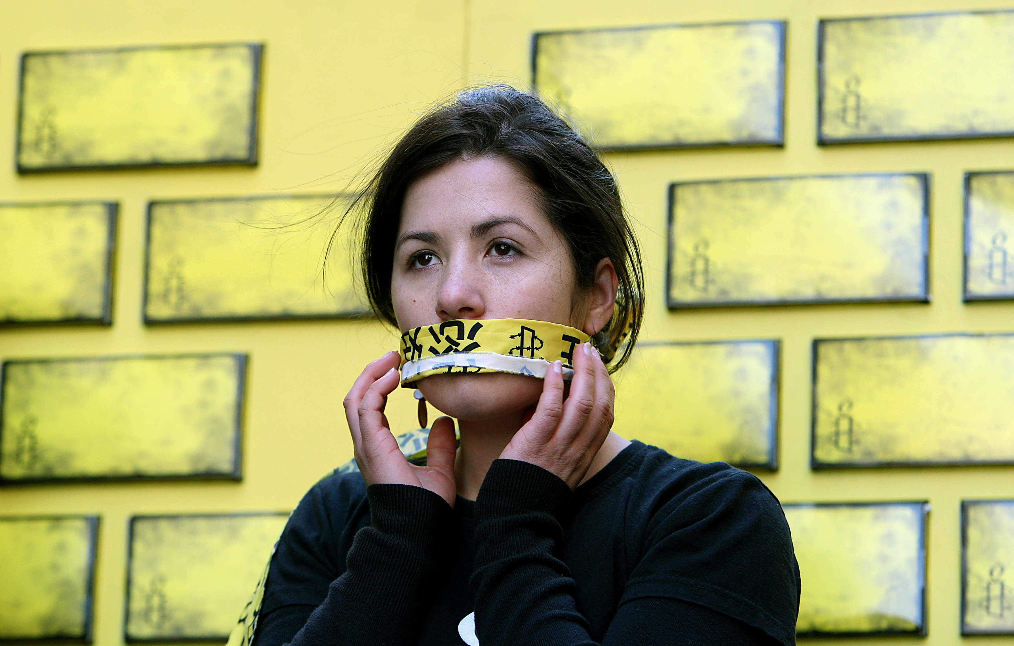 An Amnesty International member covers her mouth during a protest in Sydney against Internet censorship in China.