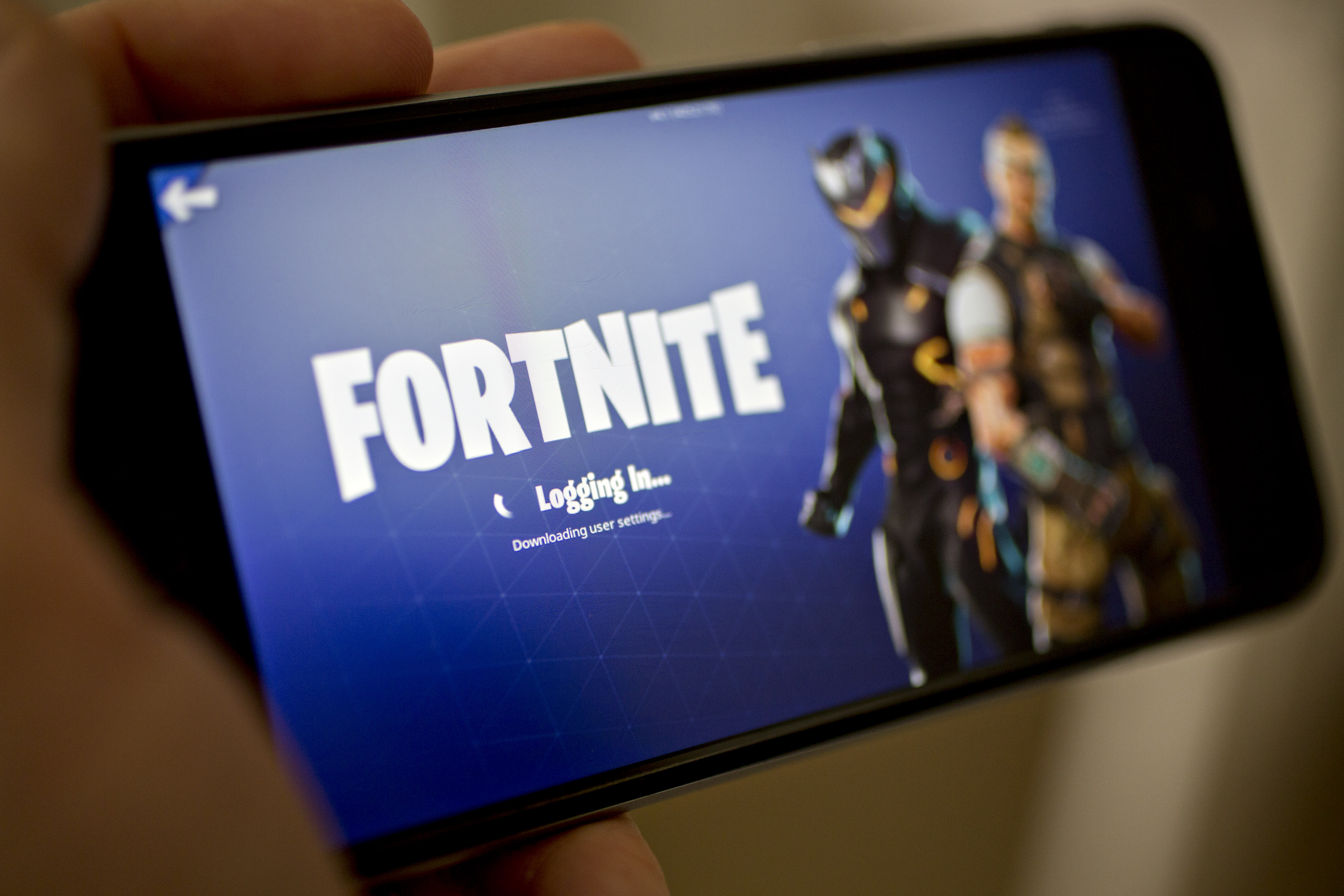 The Fortnite Battle Royale video game is displayed on an iPhone.