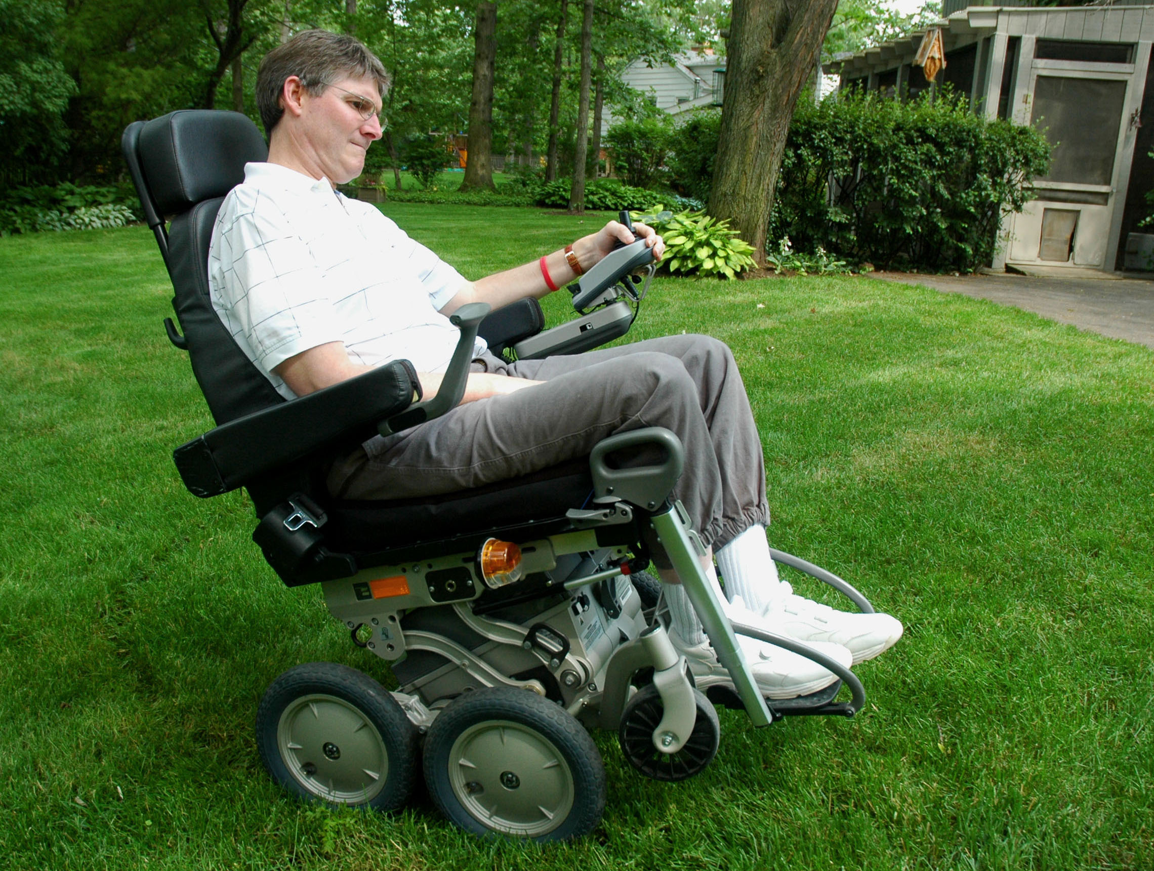Robert Gregory, 49, who suffers from multiple sclerosis, demonstrates his iBot, a high-tech wheelchair that improves mobility for the disabled, in his backyard