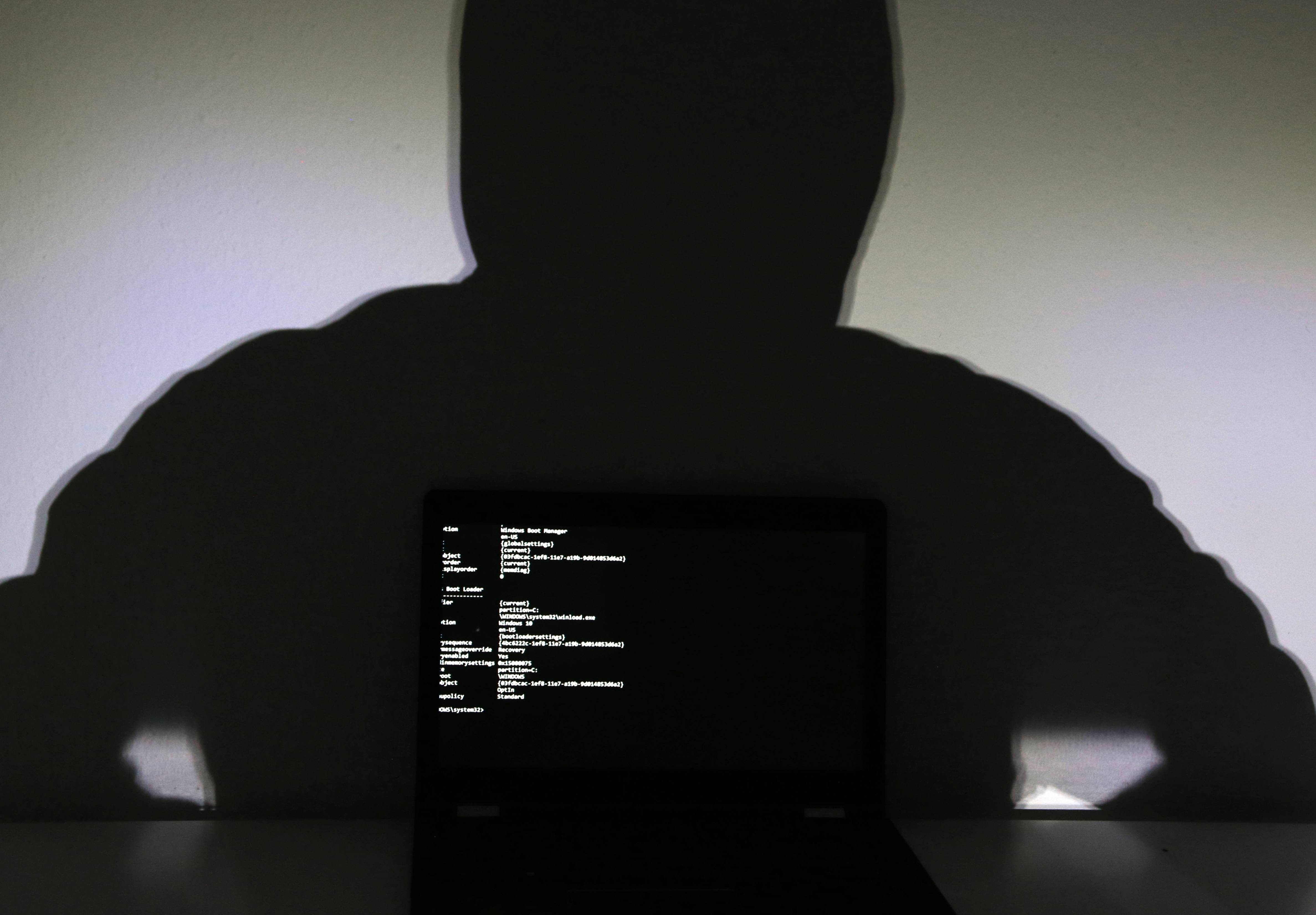 Hacker in front of the screen
