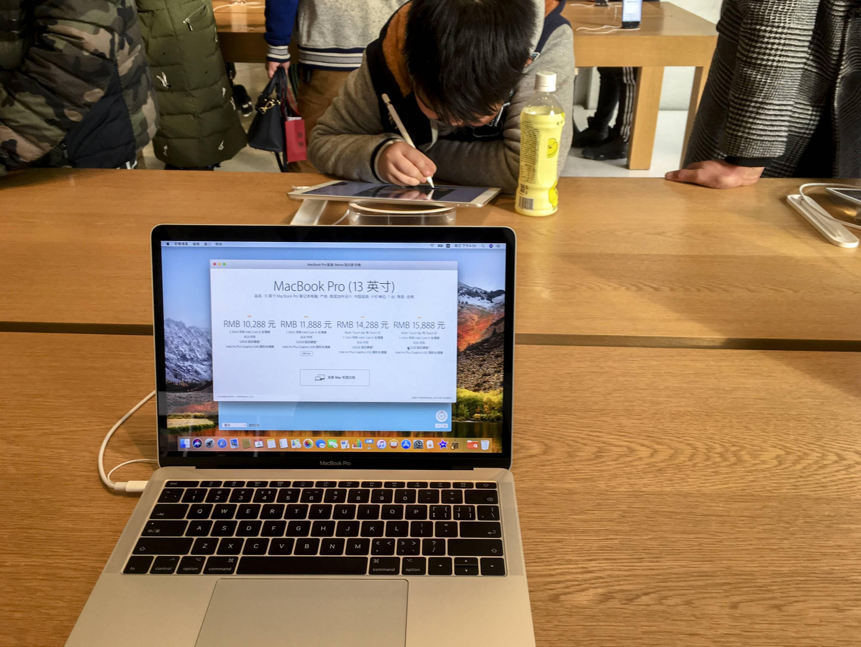 A Macbook pro shown in Apple store.