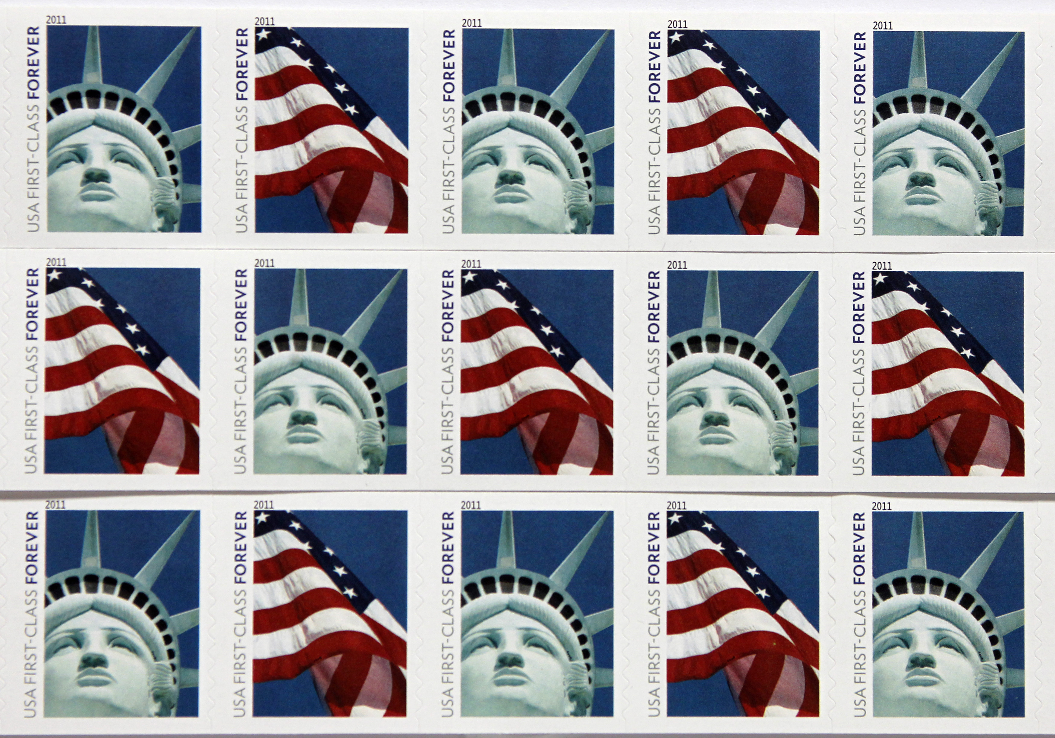 New USA First Class postage stamps, bearing an image of the Statue of Liberty and U.S. flags, are seen in Washington, April 15, 2011.