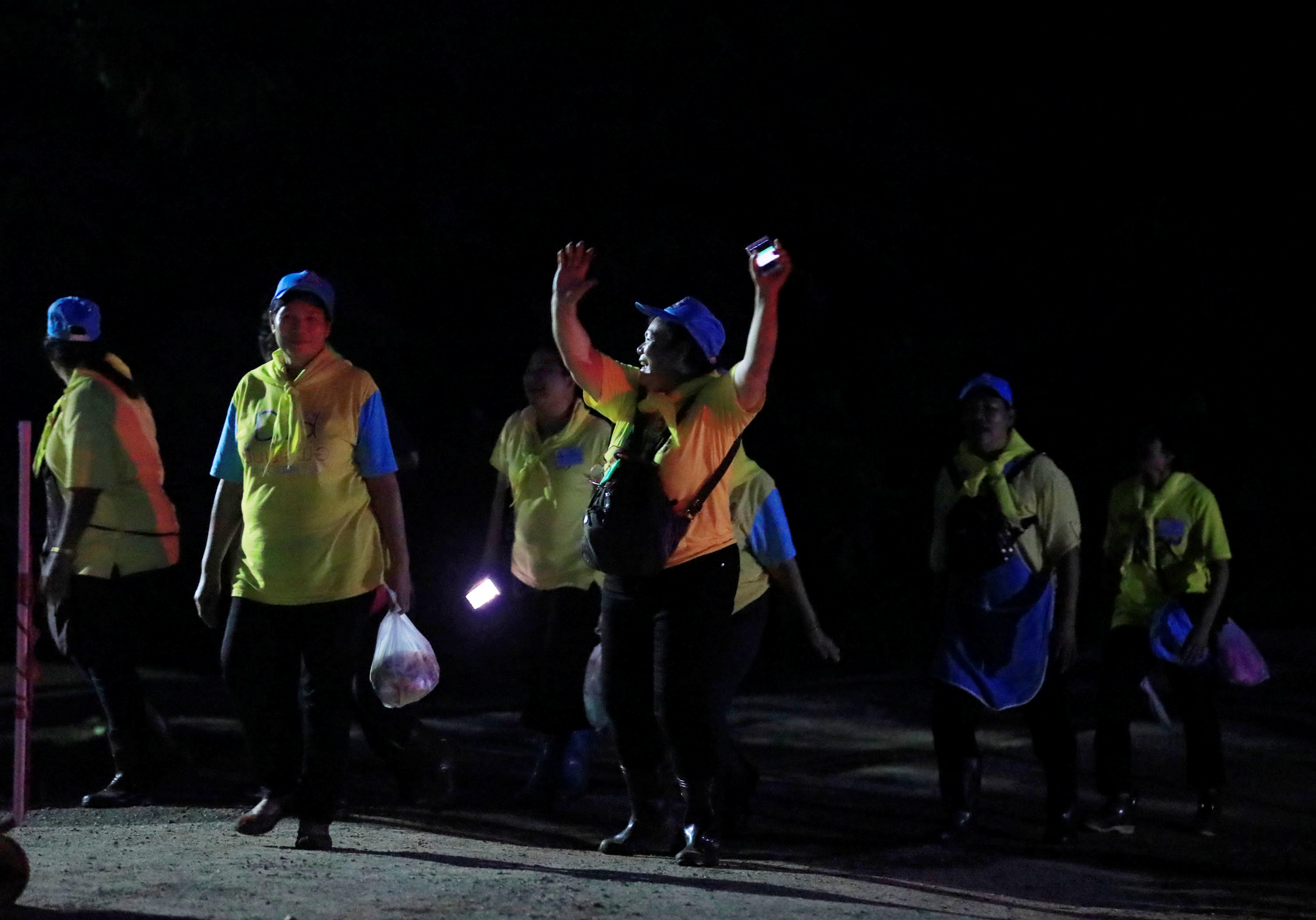 Volunteers celebrate near Tham Luang cave complex in the northern province of Chiang Rai