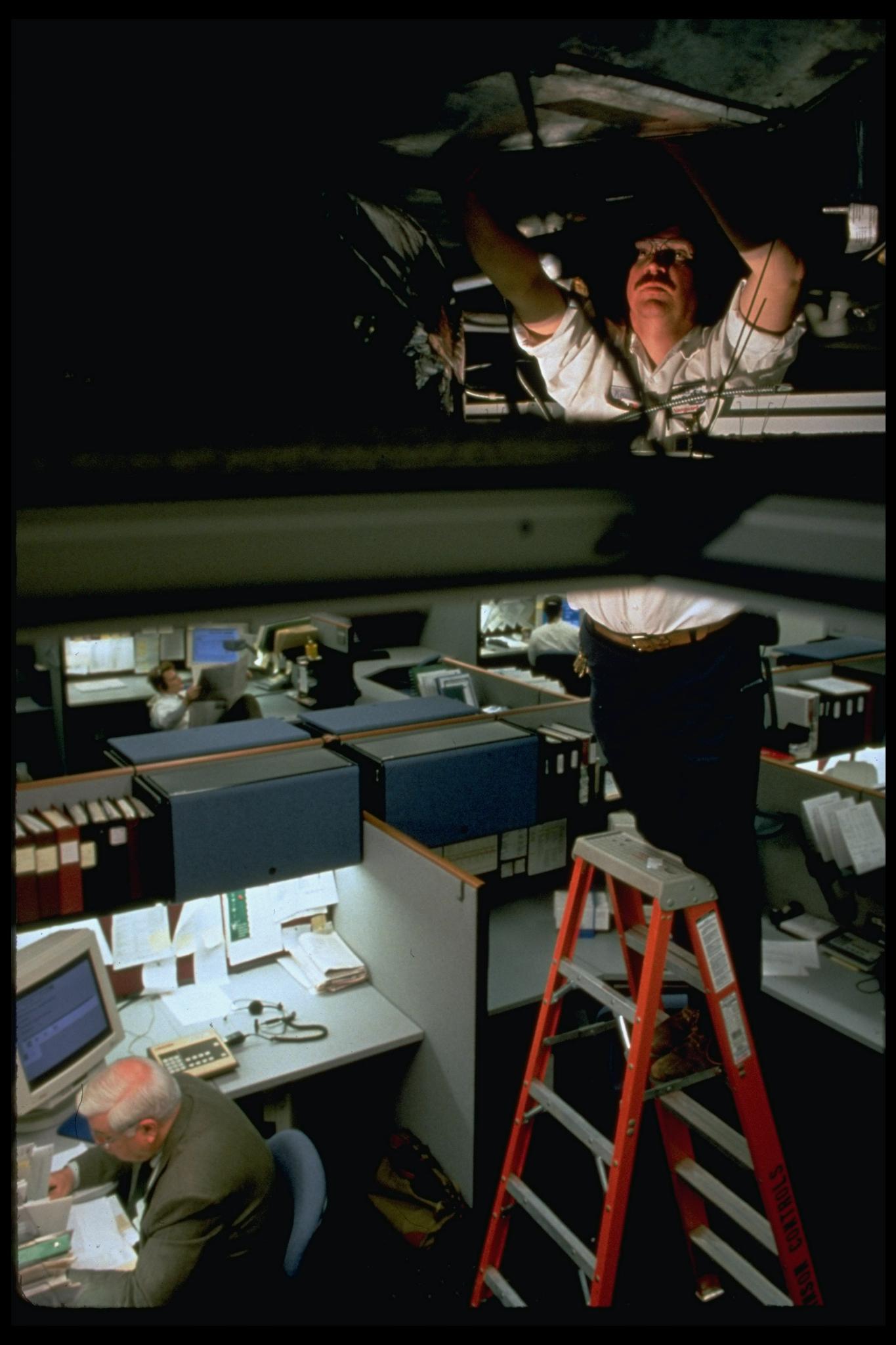 Johnson Controls worker servicing someth