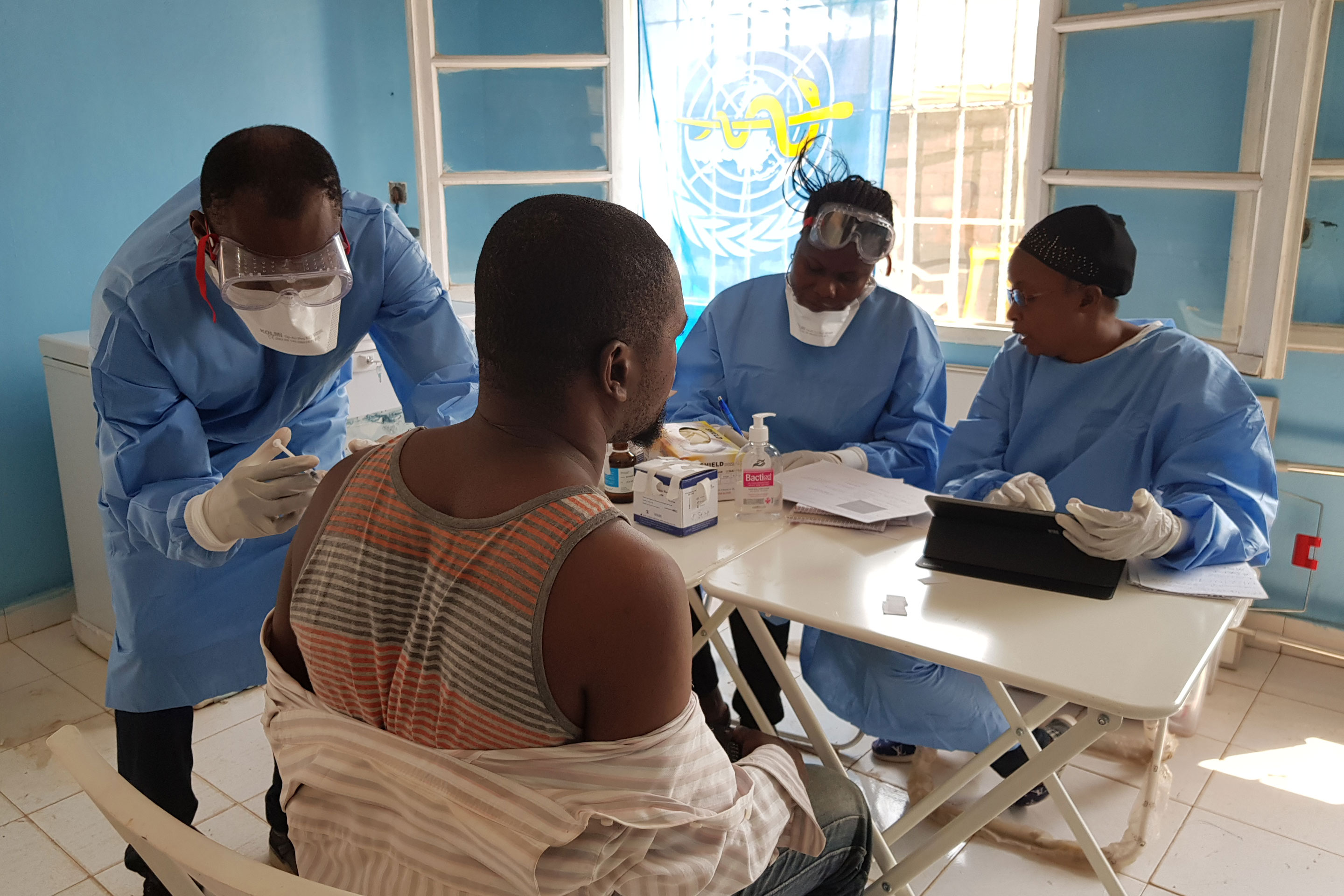 Health workers administer Merck's Ebola vaccine during an Ebola outbreak in the Democratic Republic of the Congo in July.