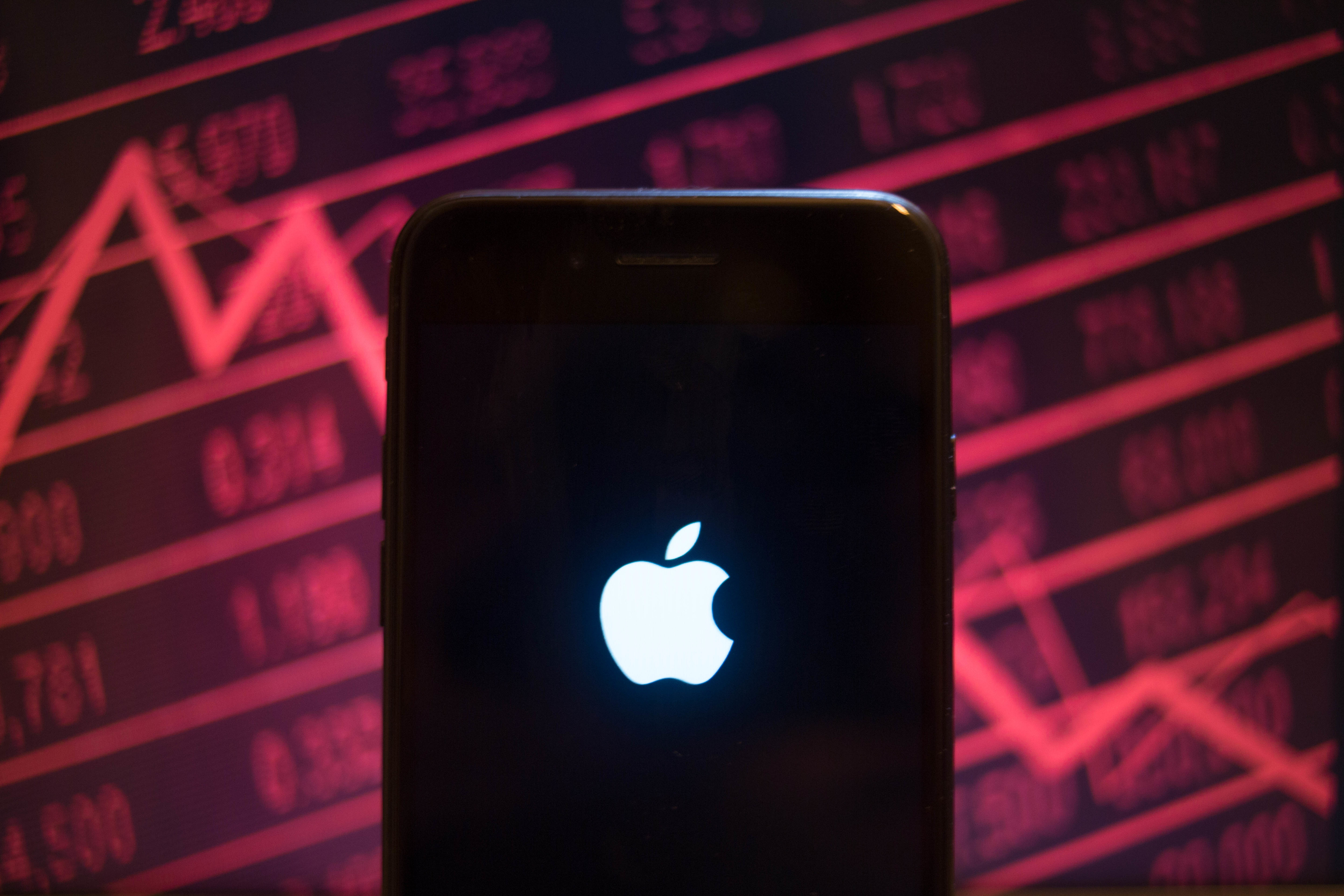 An iPhone displays the Apple logo with a background of a