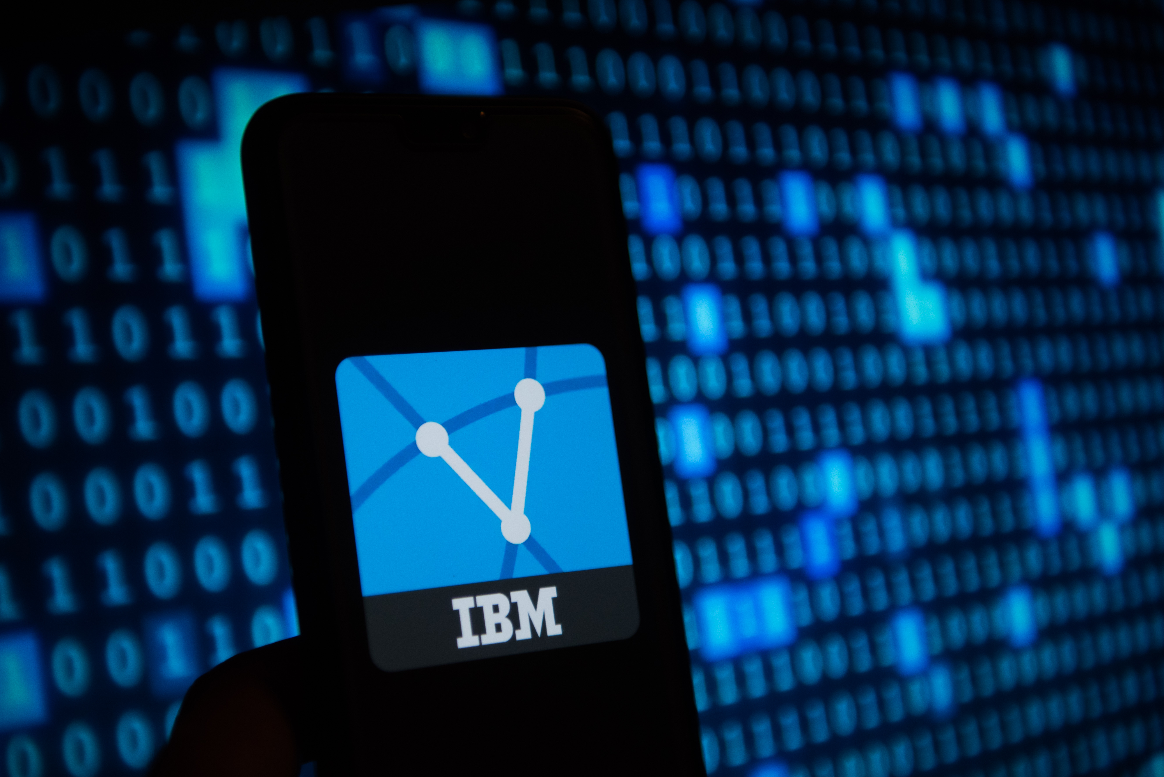 IBM  logo is seen on a mobile phone