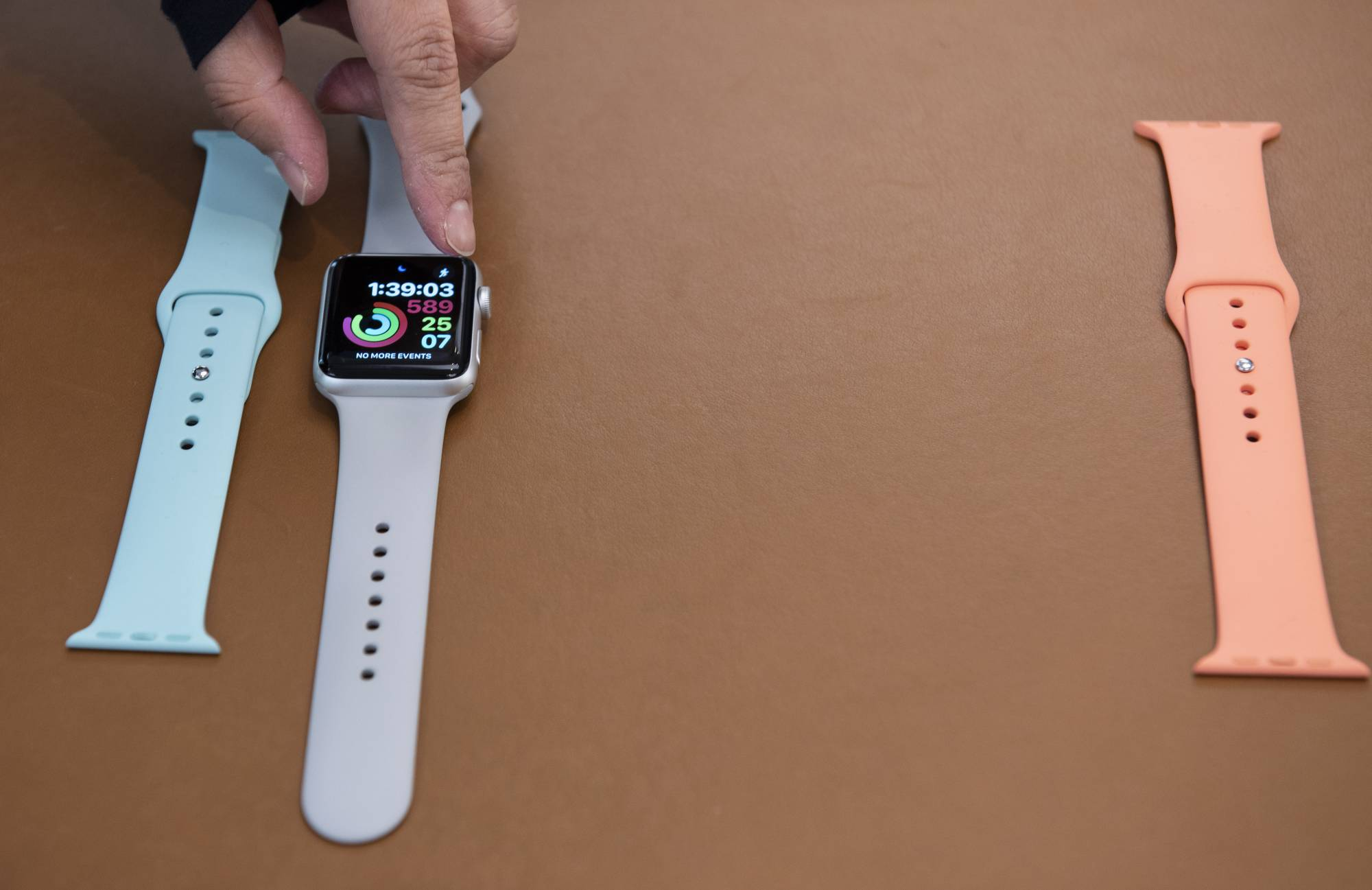Apple employee demonstrates different Apple watch functions and