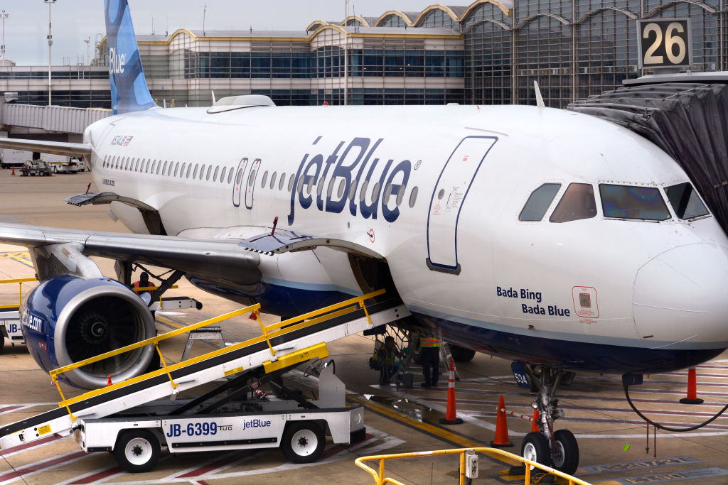 WASHINGTON, D.C. - APRIL 24, 2018:  A JetBlue Airways Airbus A320 jet is serviced at a gate at Ronald Reagan Washington National Airport in Washington, D.C. (Photo by Robert Alexander/Getty Images)