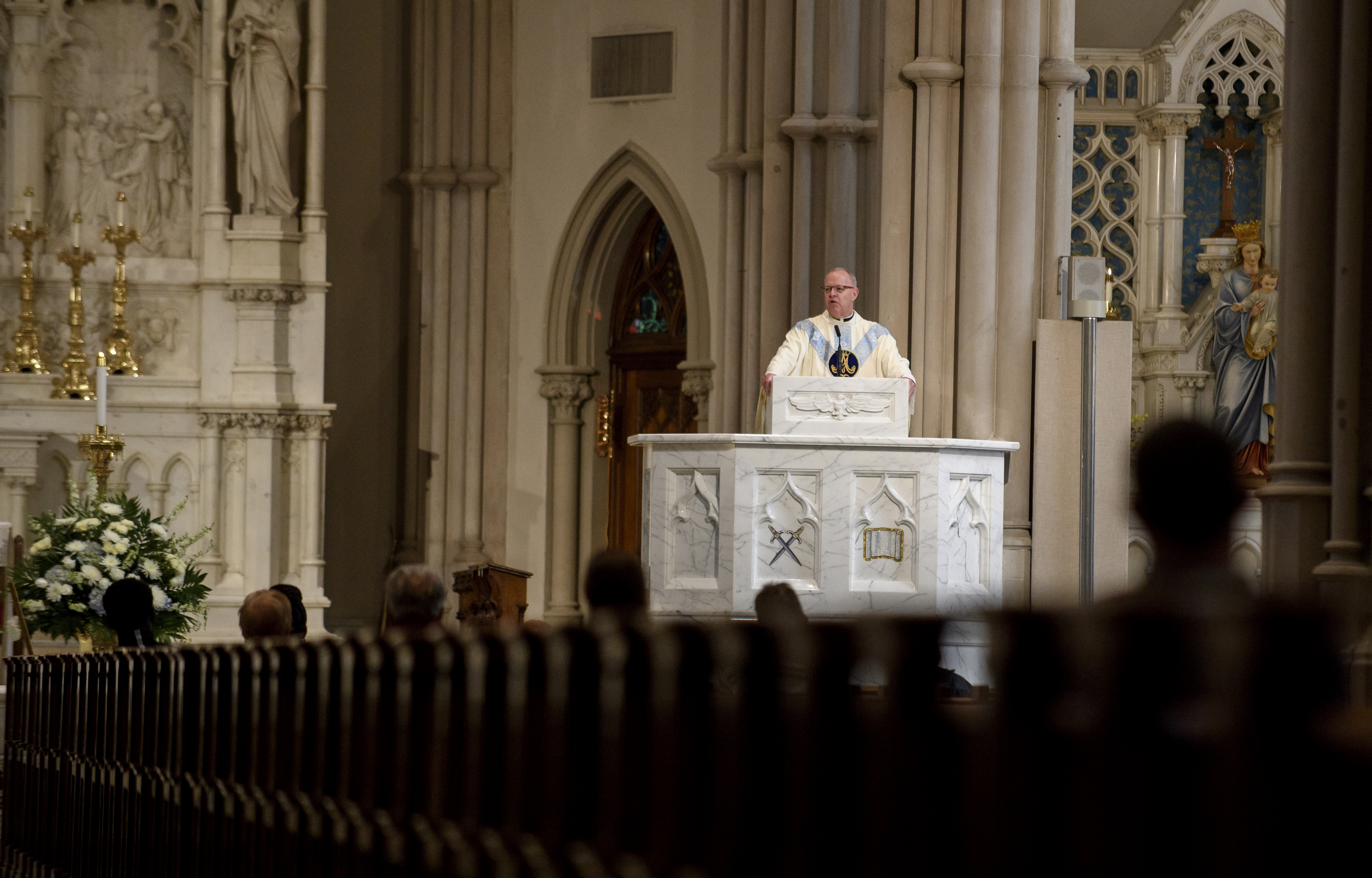 Father Kris Stubna speaks to parishioners at St. Paul Cathedral, the mother church of the Pittsburgh Diocese, on August 15, 2018, in Pittsburgh, Penn.