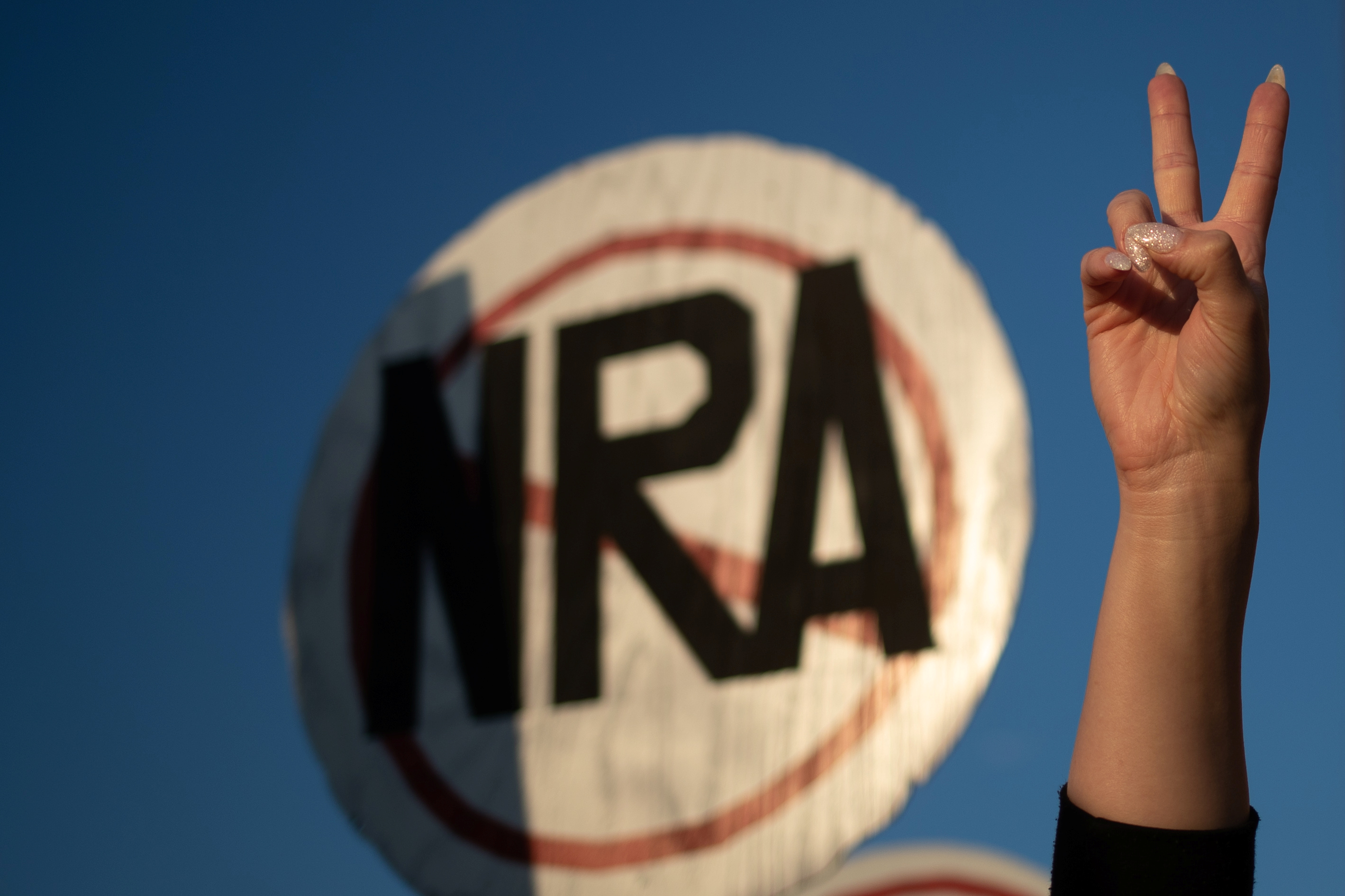 An activist takes part in protest march against NRA in Dallas, Texas