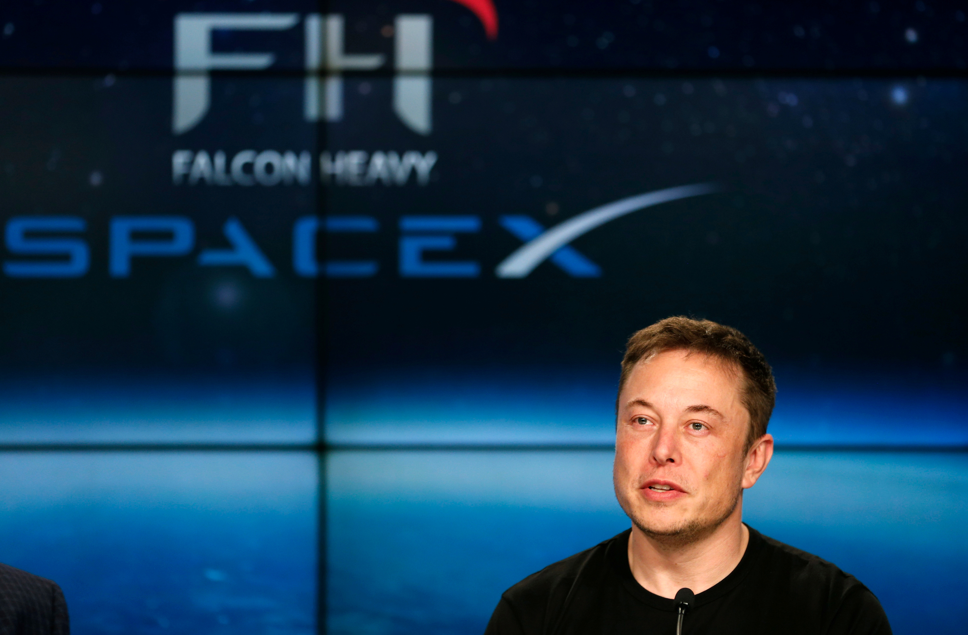 FILE PHOTO: SpaceX founder Musk speaks at a press conference following the first launch of a SpaceX Falcon Heavy rocket in Cape Canaveral