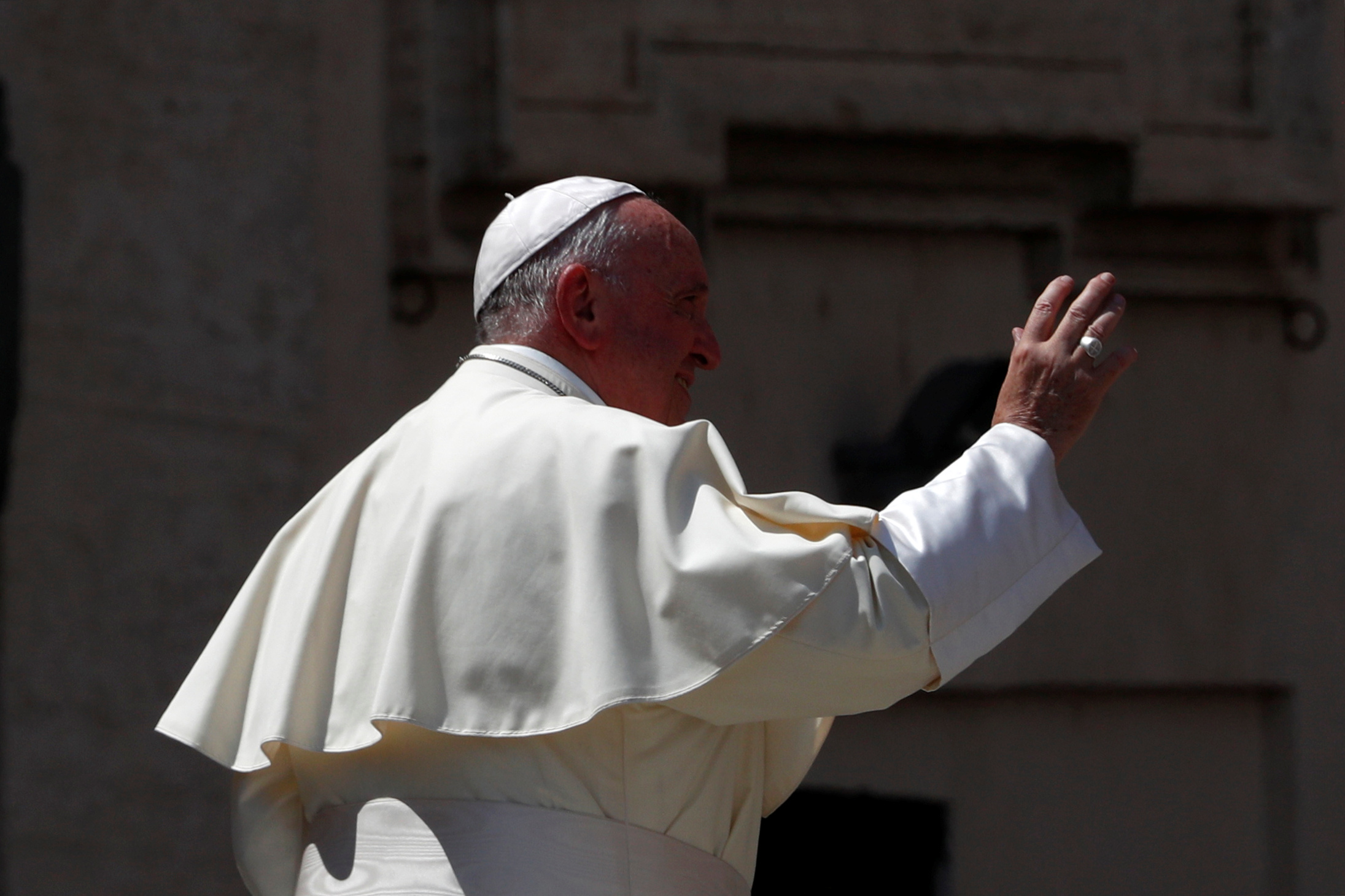 Pope Francis waves as he leaves after a meeting with Cardinal Gualtiero Bassetti in St. Peter's square at the Vatican