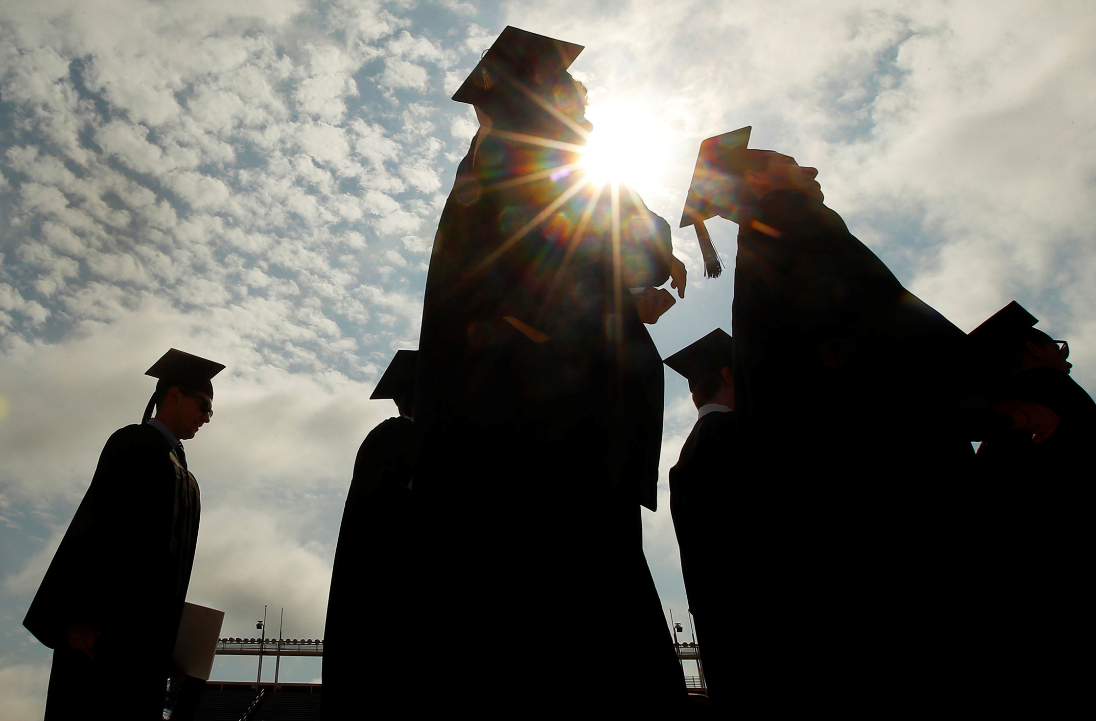 FILE PHOTO: Graduating students arrive for Commencement Exercises at Boston College in Boston